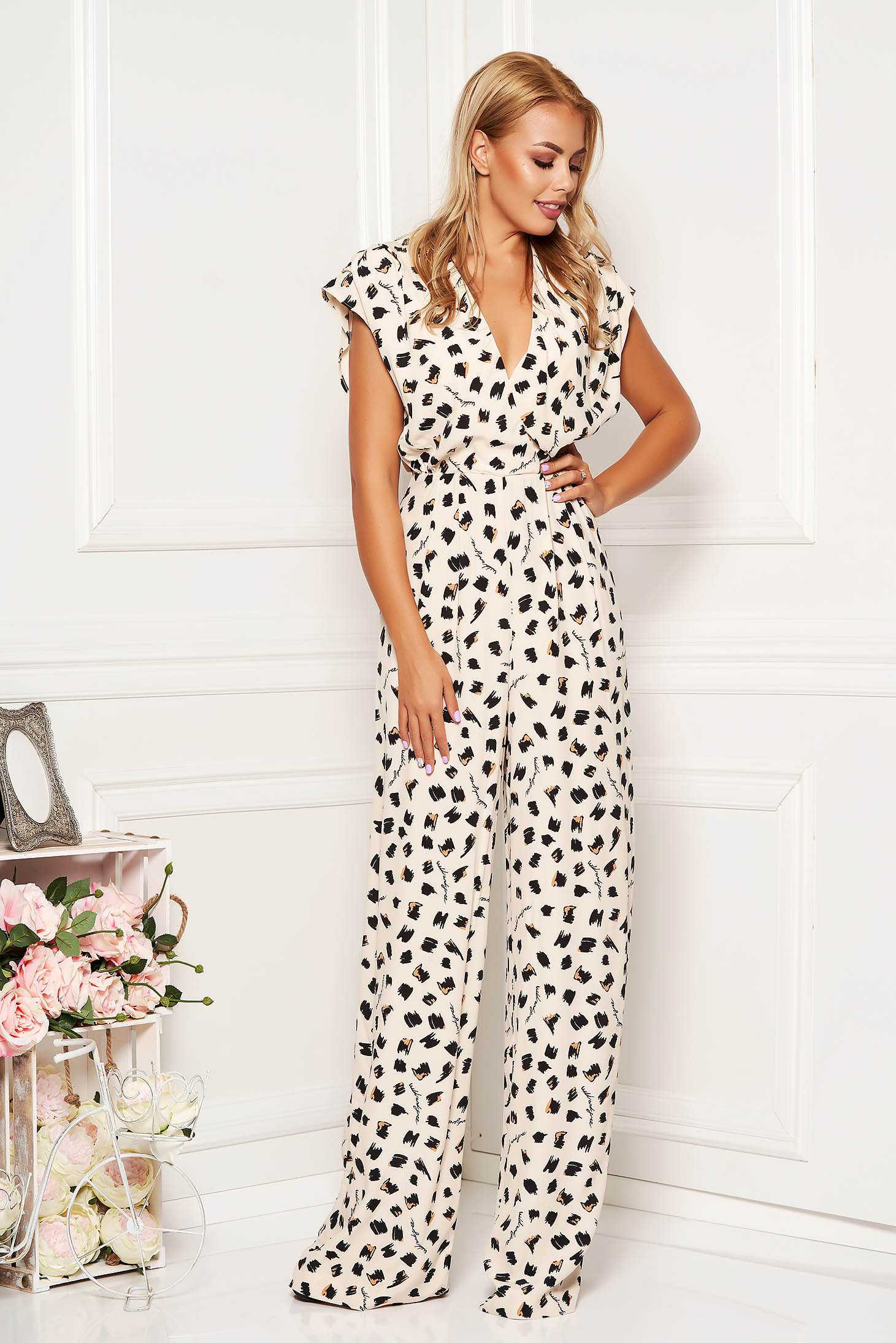 Nude jumpsuit elegant long flared animal print with v-neckline with padded shoulders