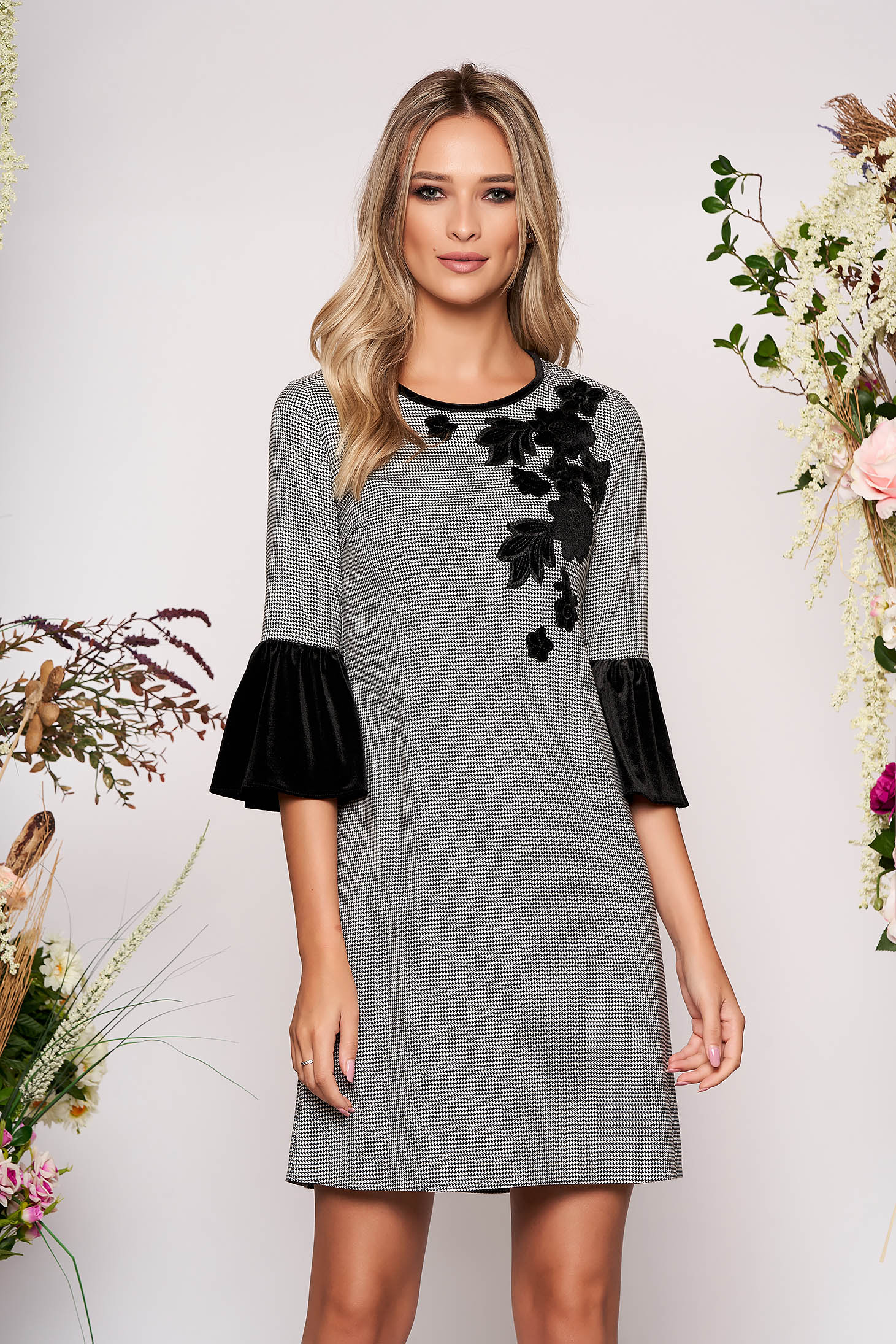 Elegant a-line black dress with bell sleeves with chequers and rounded cleavage
