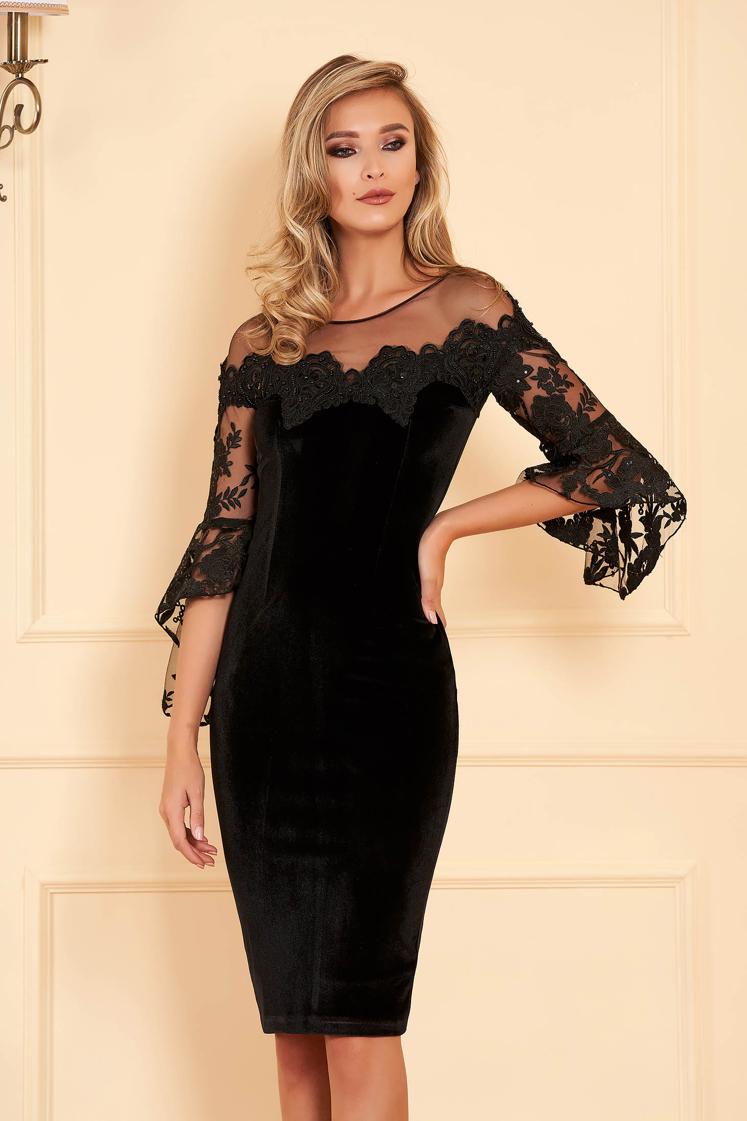 Black occasional dress with tented cut from velvet and laced fabric with small beads embellished details