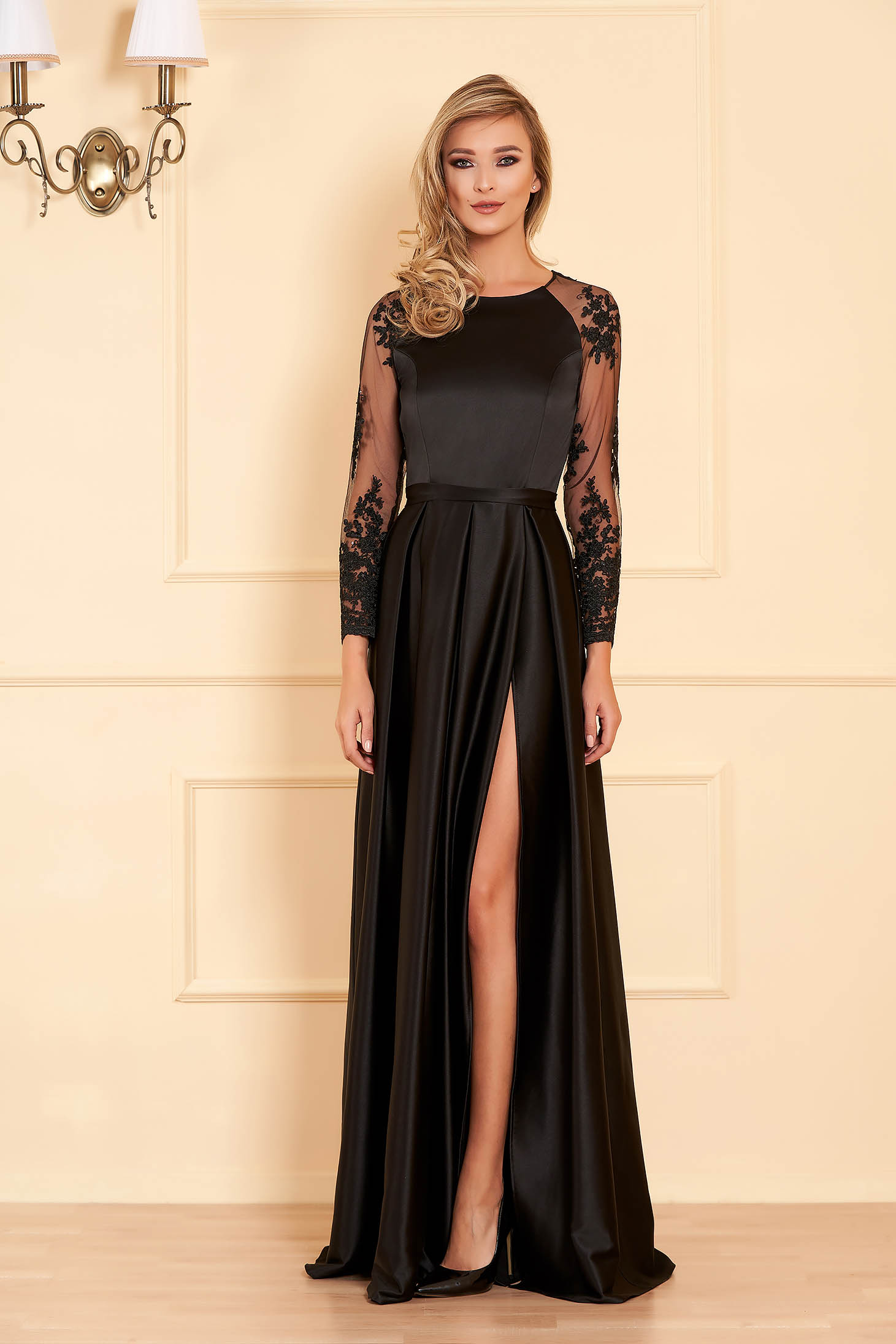 Black occasional dress flaring cut from satin fabric texture with laced sleeves