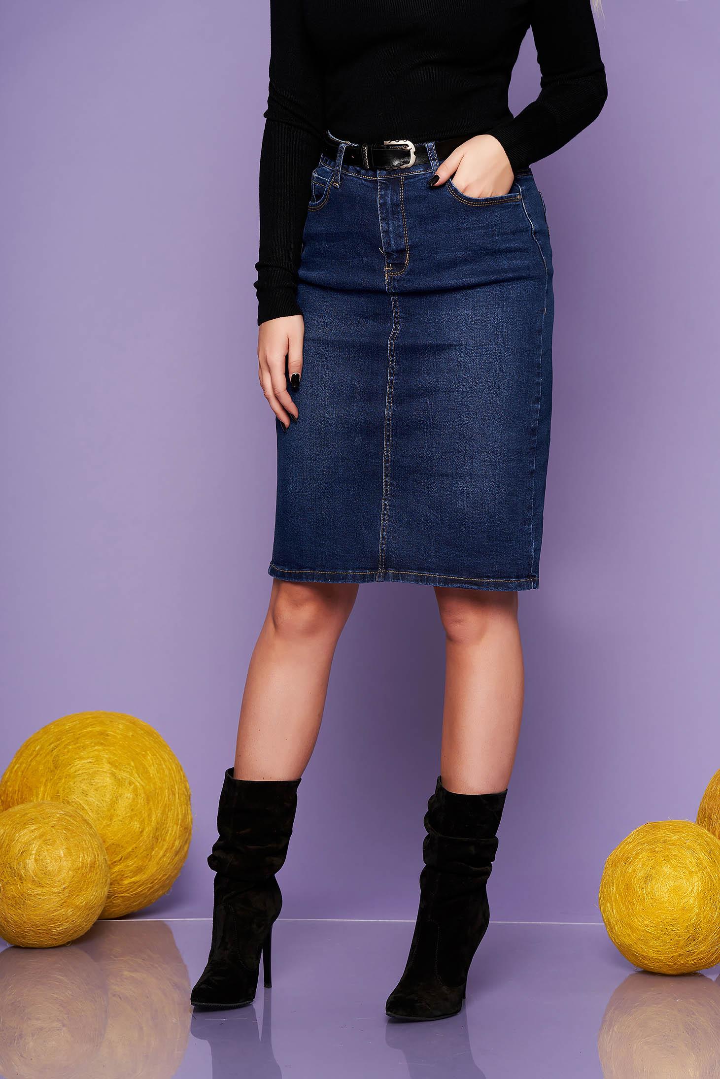 Darkblue midi denim skirt medium waist with tented cut accessorized with belt
