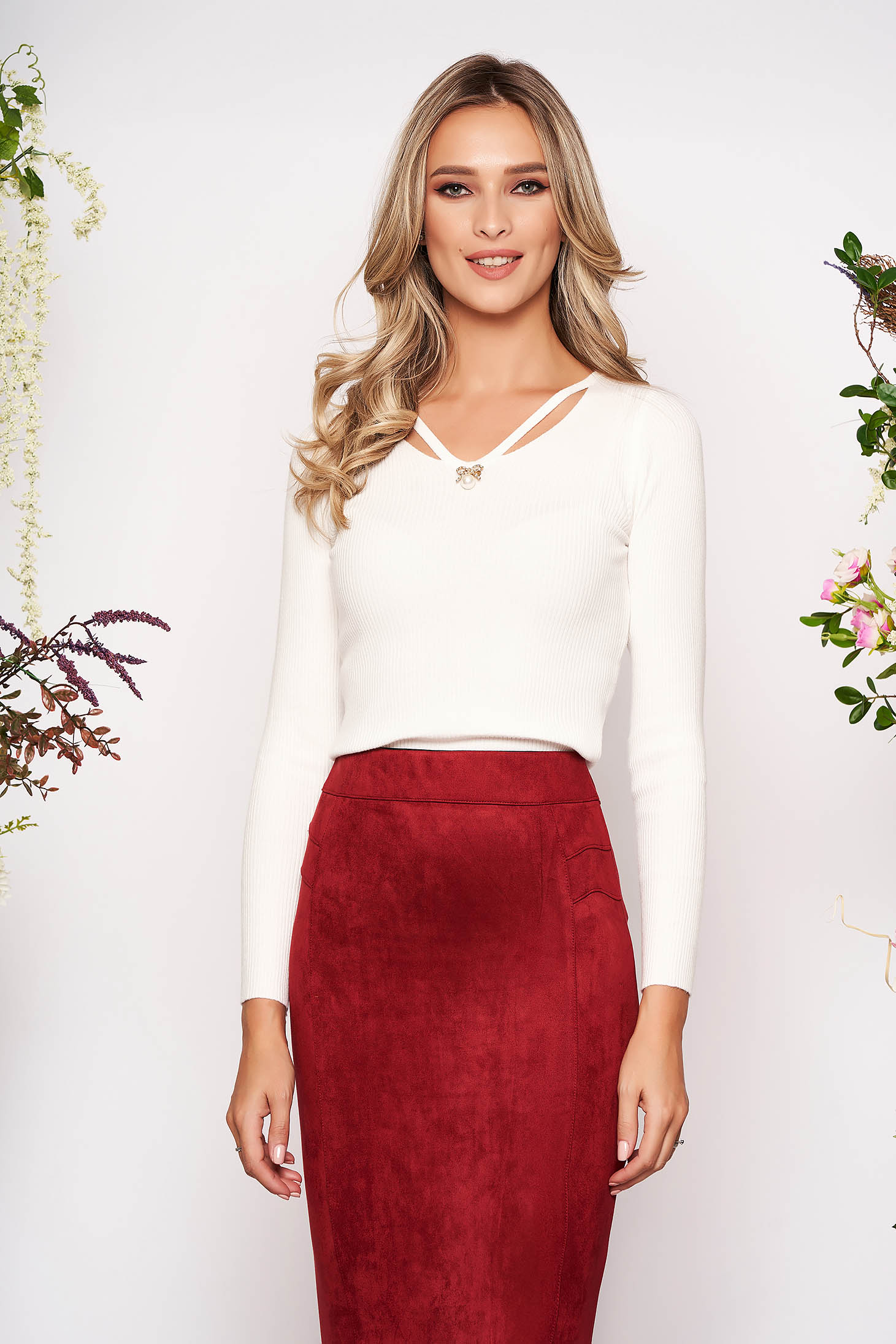 White knitted tented women`s blouse long sleeve with v-neckline front cut-out design accessorized with breastpin