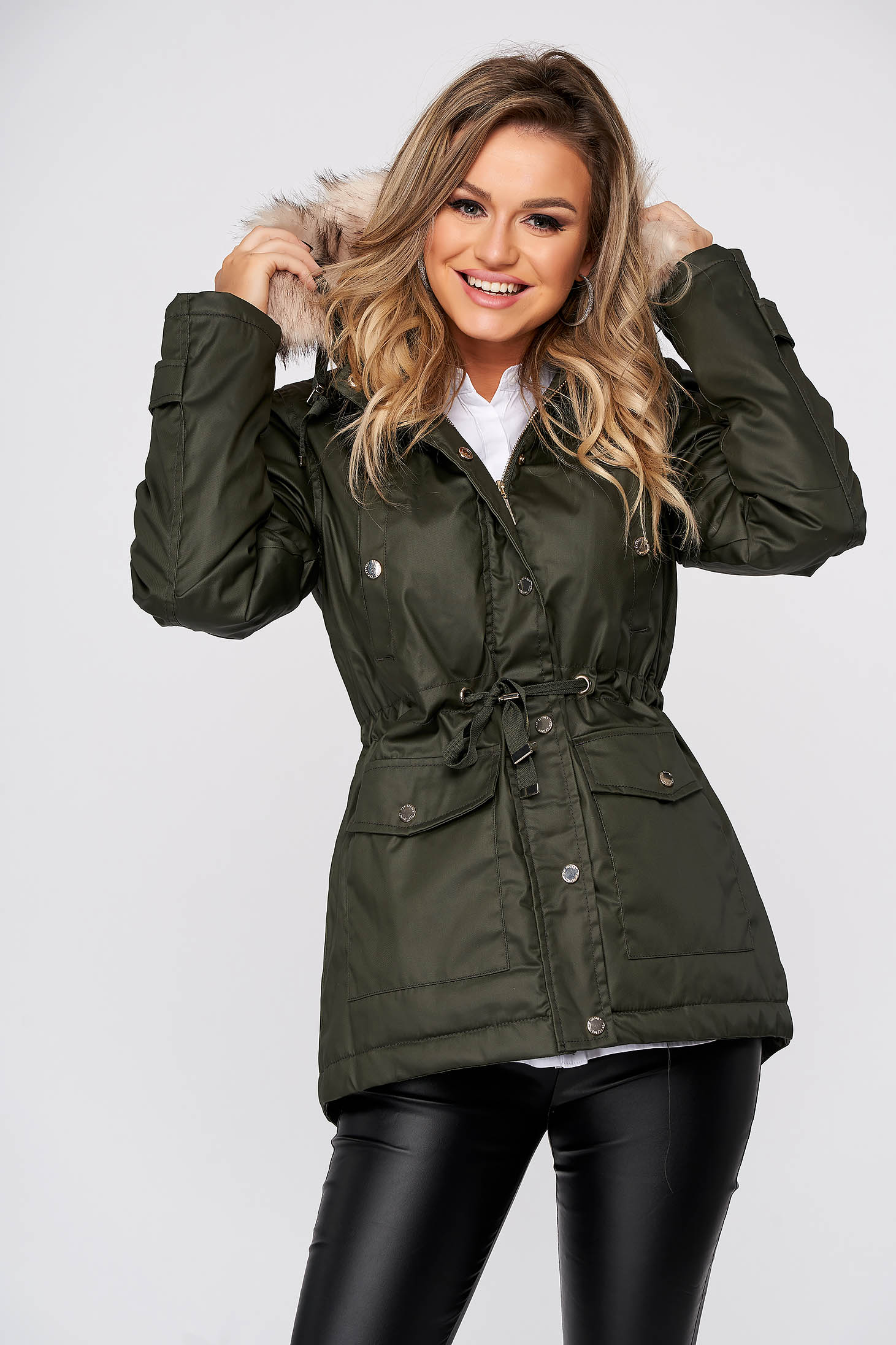 Green casual jacket from shiny fabric with faux fur lining is fastened around the waist with a ribbon