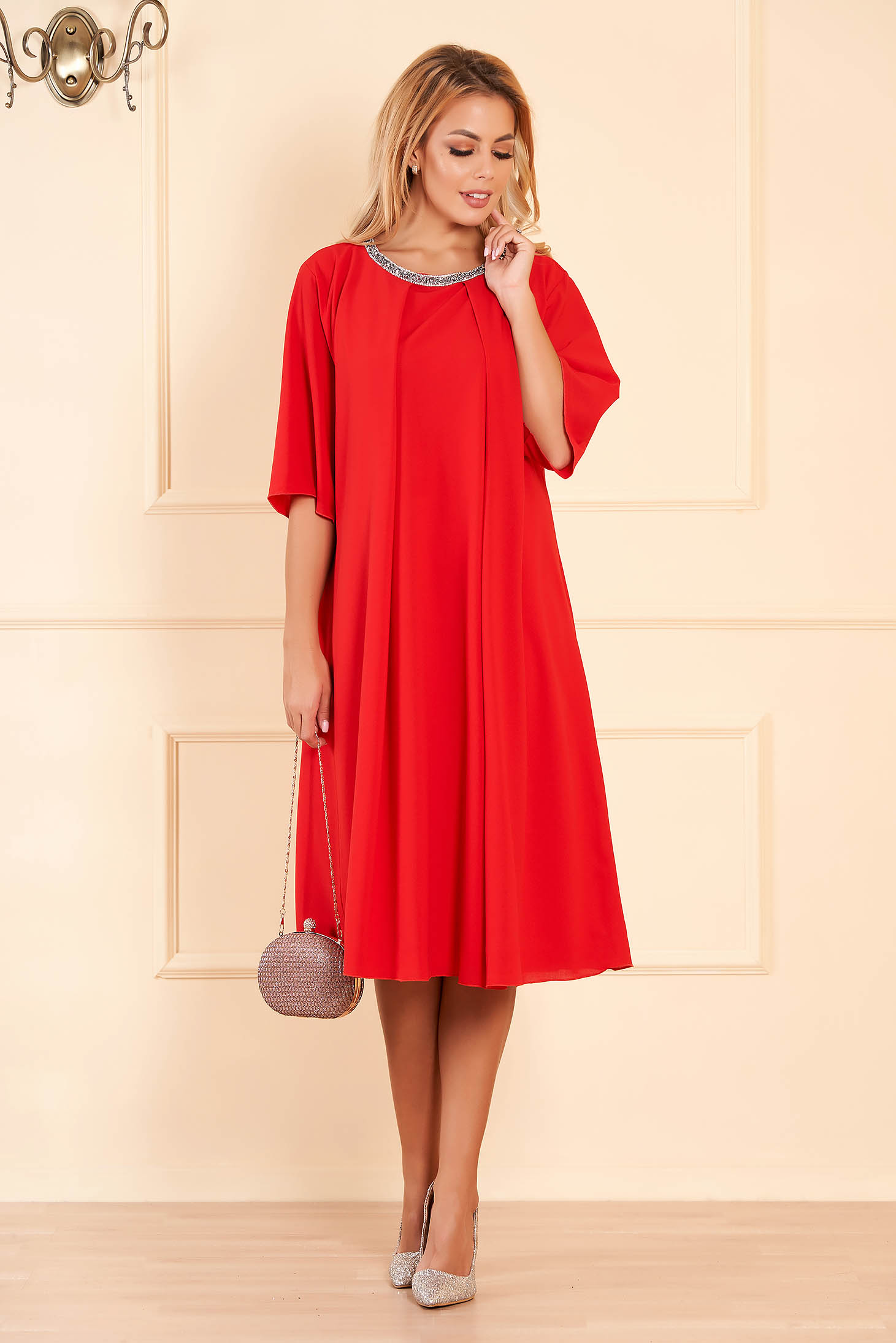 Red occasional flared dress from veil fabric with bright details