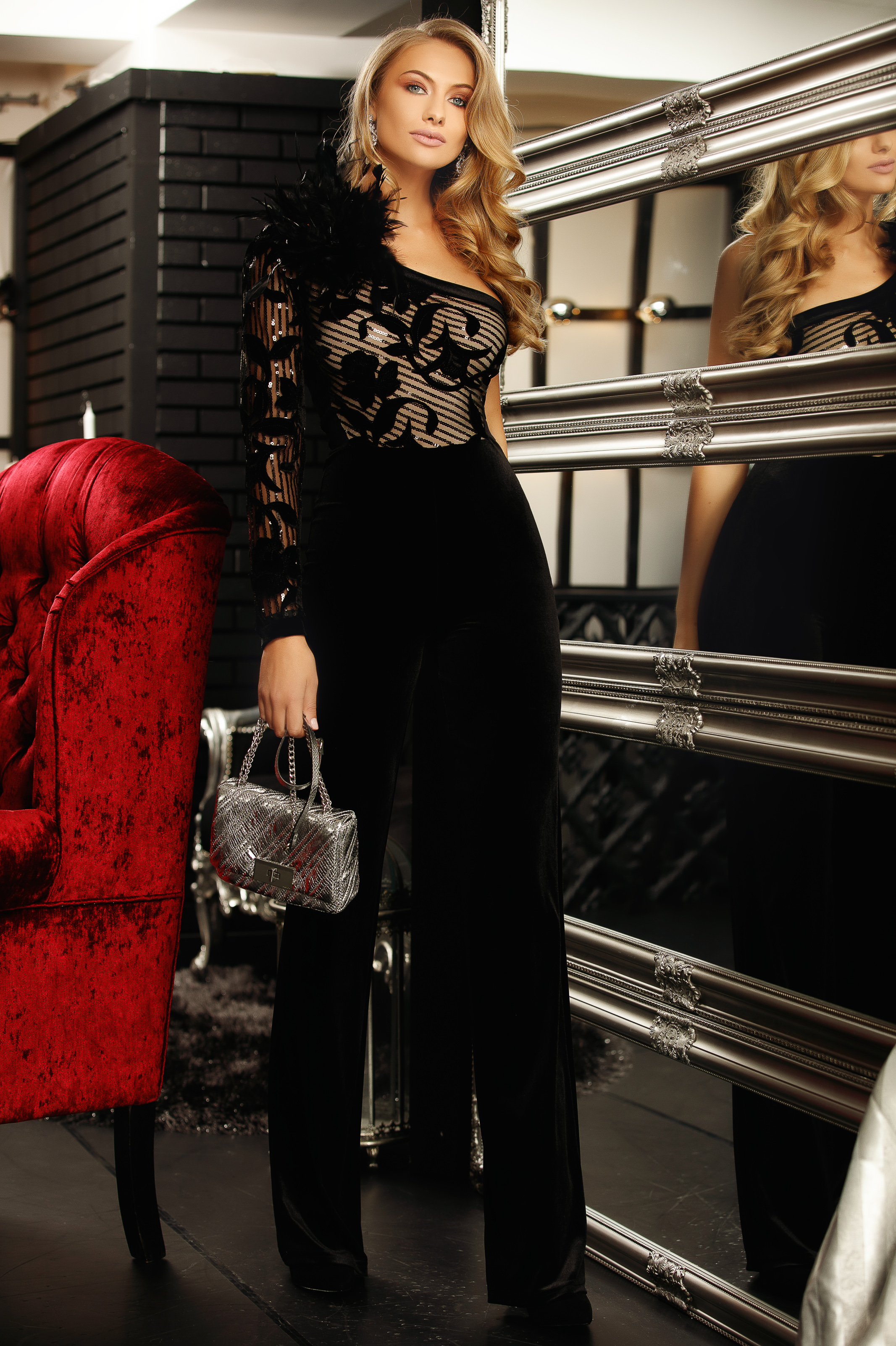 Black occasional from velvet jumpsuit flaring cut with sequin embellished details