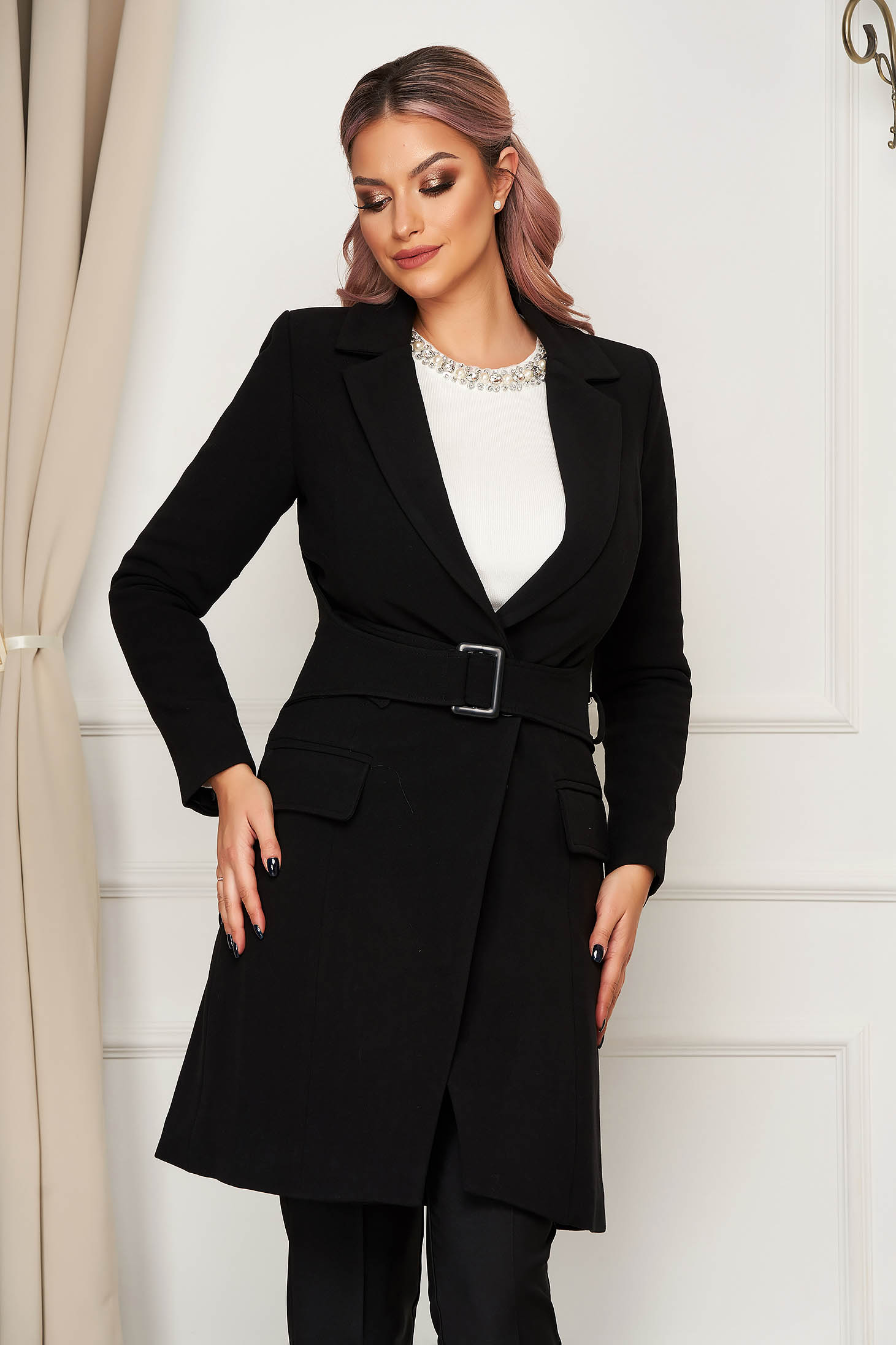 Trenchcoat black accessorized with tied waistband with pockets with inside lining cloth straight long sleeved with padded shoulders