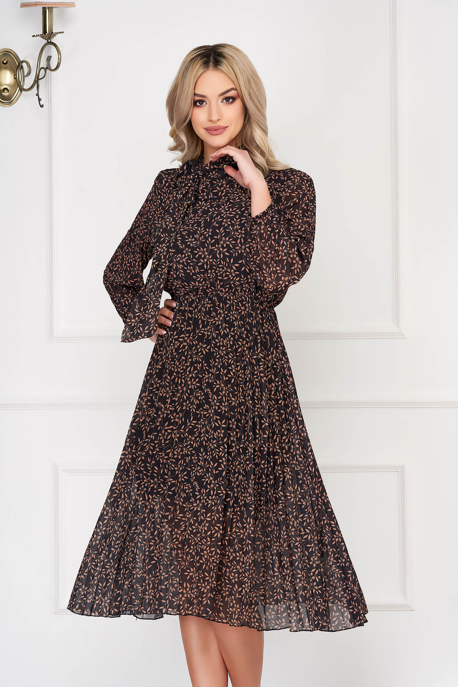 Brown dress long sleeved flaring cut pleats of material from veil elastic waist