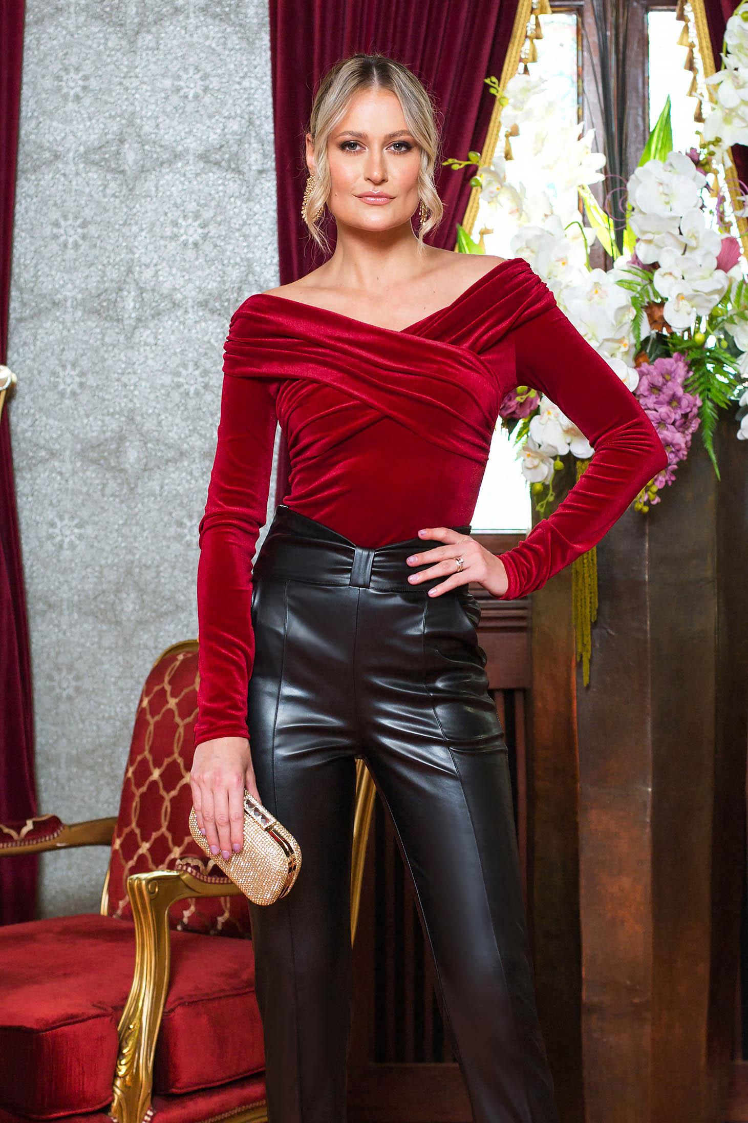 Red women`s blouse clubbing from velvet naked shoulders long sleeved tented