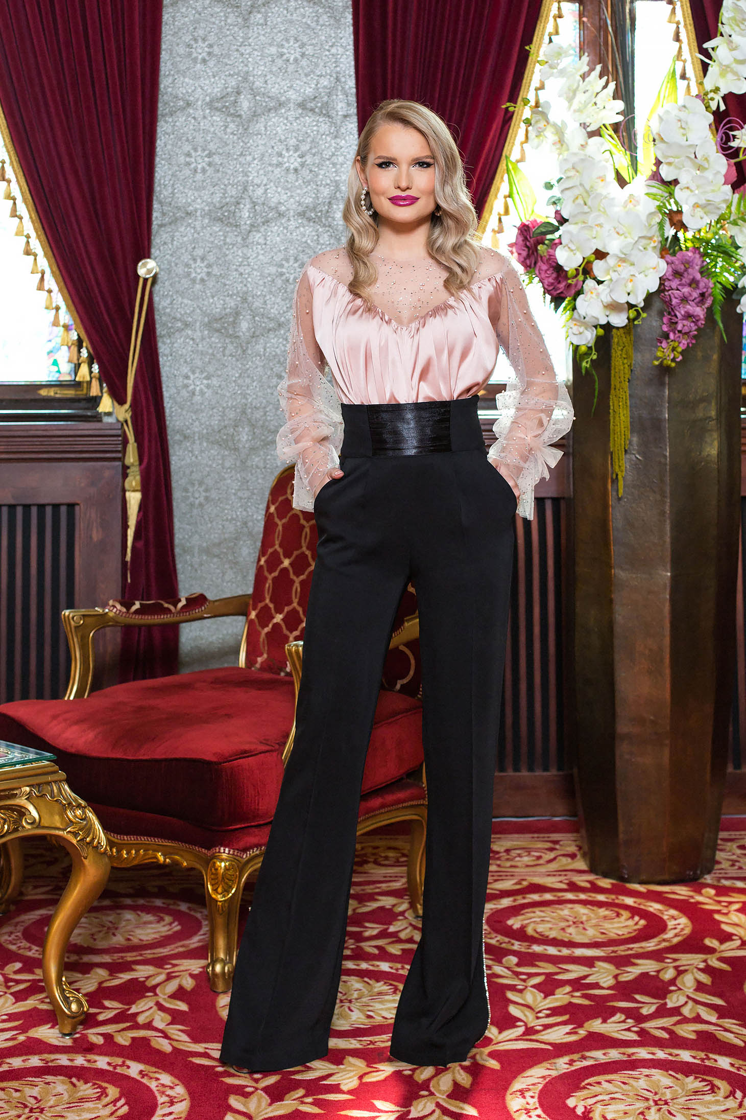 Black trousers occasional high waisted flared accessorized with a waistband