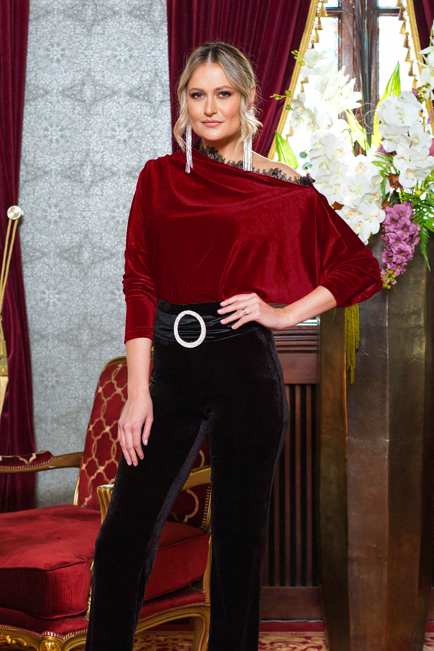 Red women`s blouse occasional from velvet with lace details