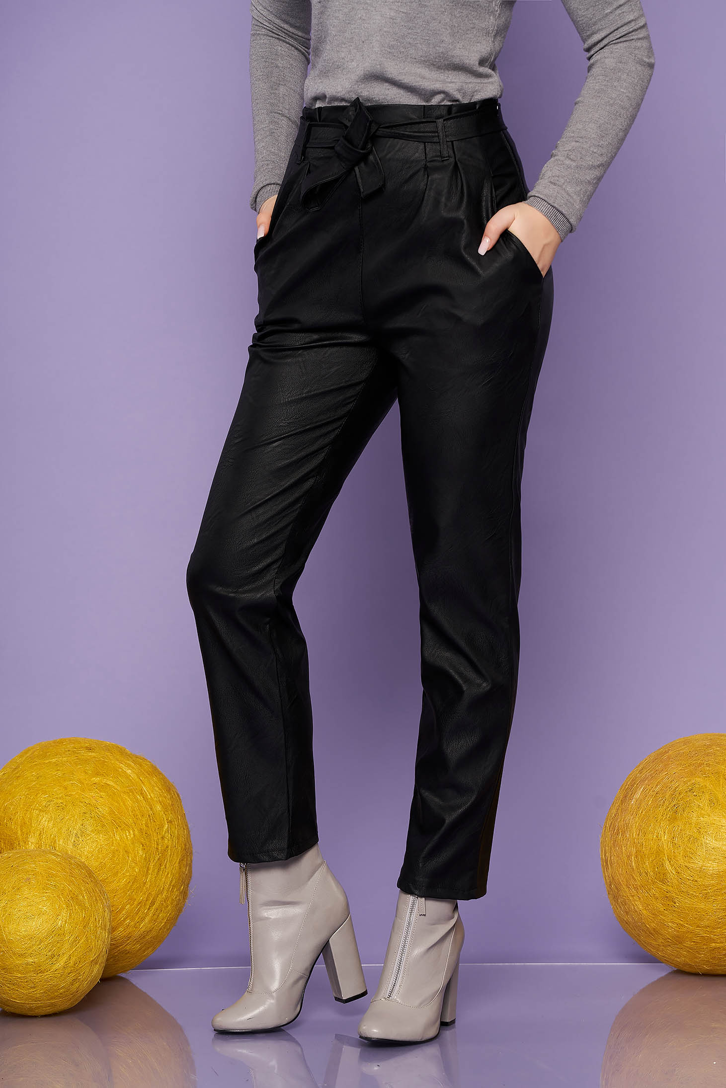 Trousers black casual from ecological leather conical high waisted accessorized with tied waistband with pockets