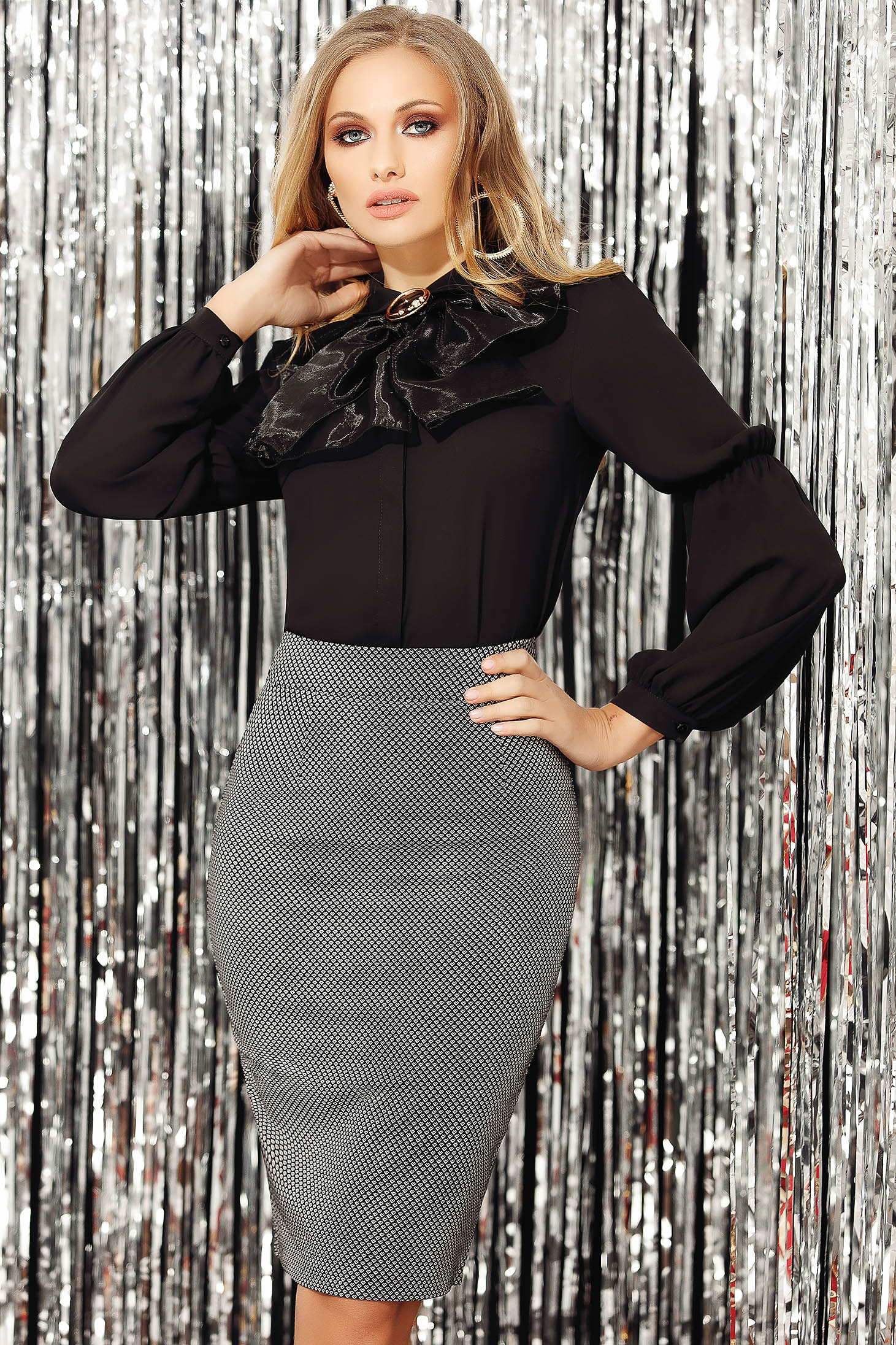 Black women`s blouse elegant short cut long sleeved from veil fabric accessorized with breastpin