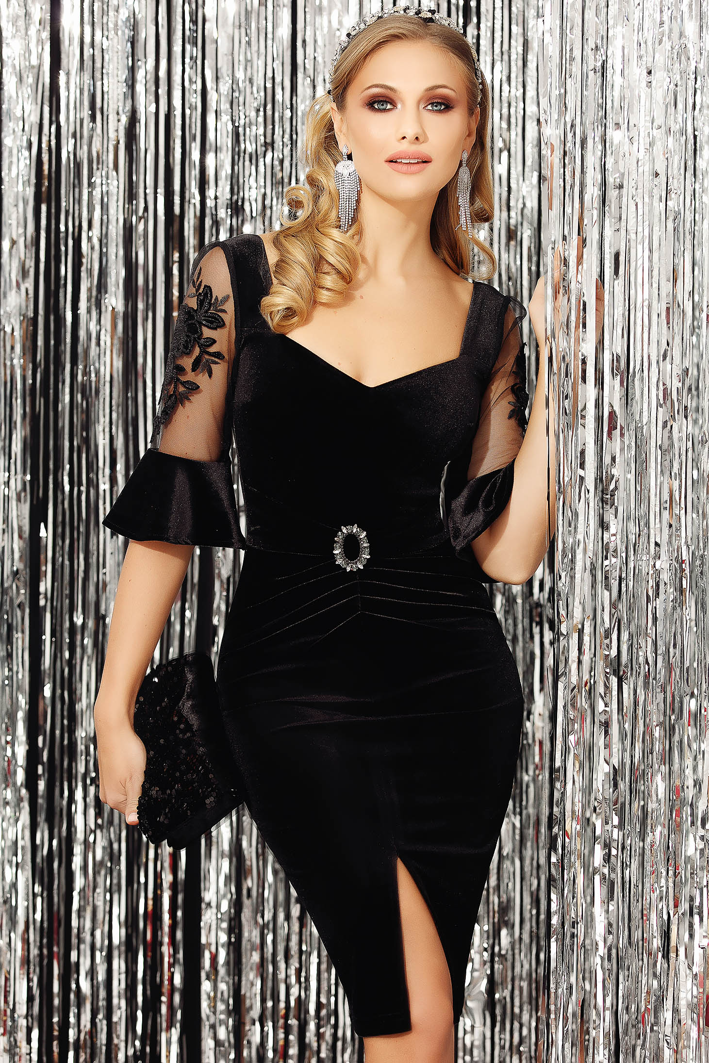 Black dress occasional with 3/4 sleeves from velvet arched cut accessorized with breastpin slit