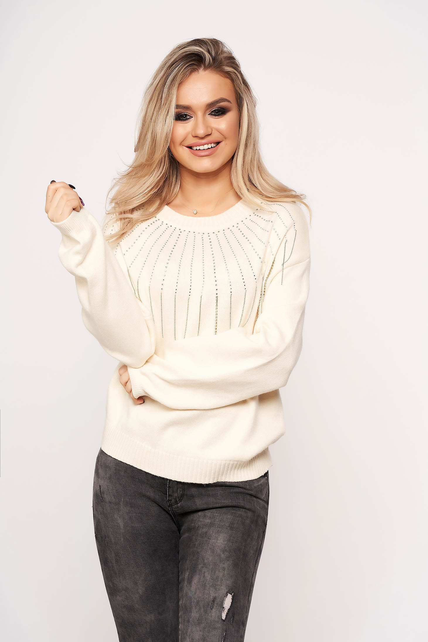 Ivory sweater long sleeve with crystal embellished details with rounded cleavage accessorized with chain casual