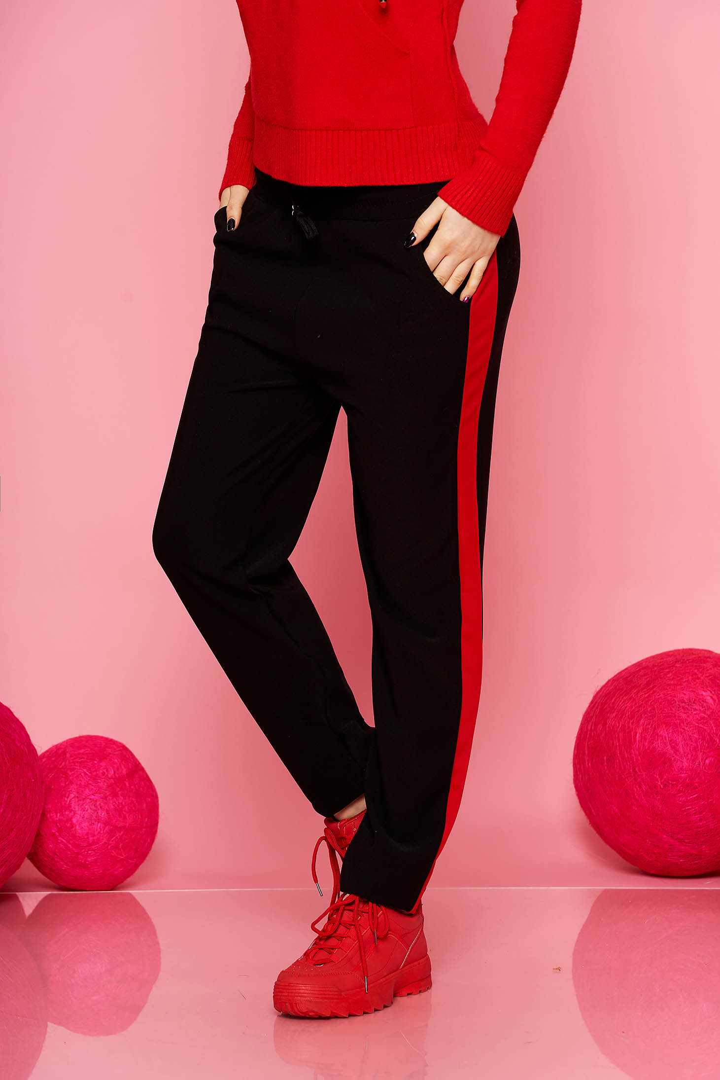 Red trousers casual with pockets with elastic waist is fastened around the waist with a ribbon straight