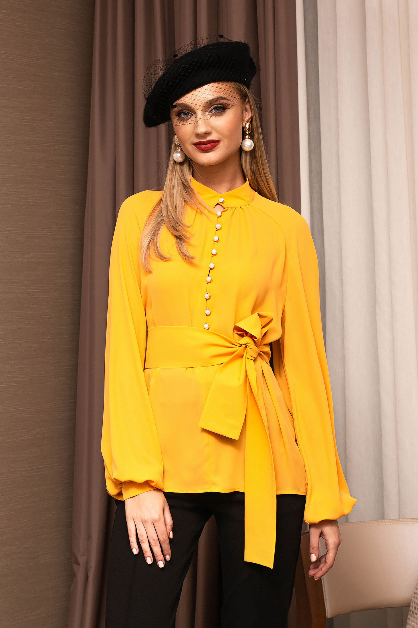 Yellow elegant flared women`s blouse bell sleeves with puffed sleeves from veil fabric