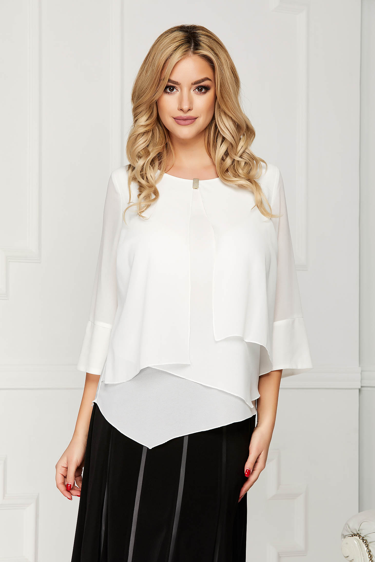 White office asymmetrical flared women`s blouse short cut from veil fabric with metal accessories