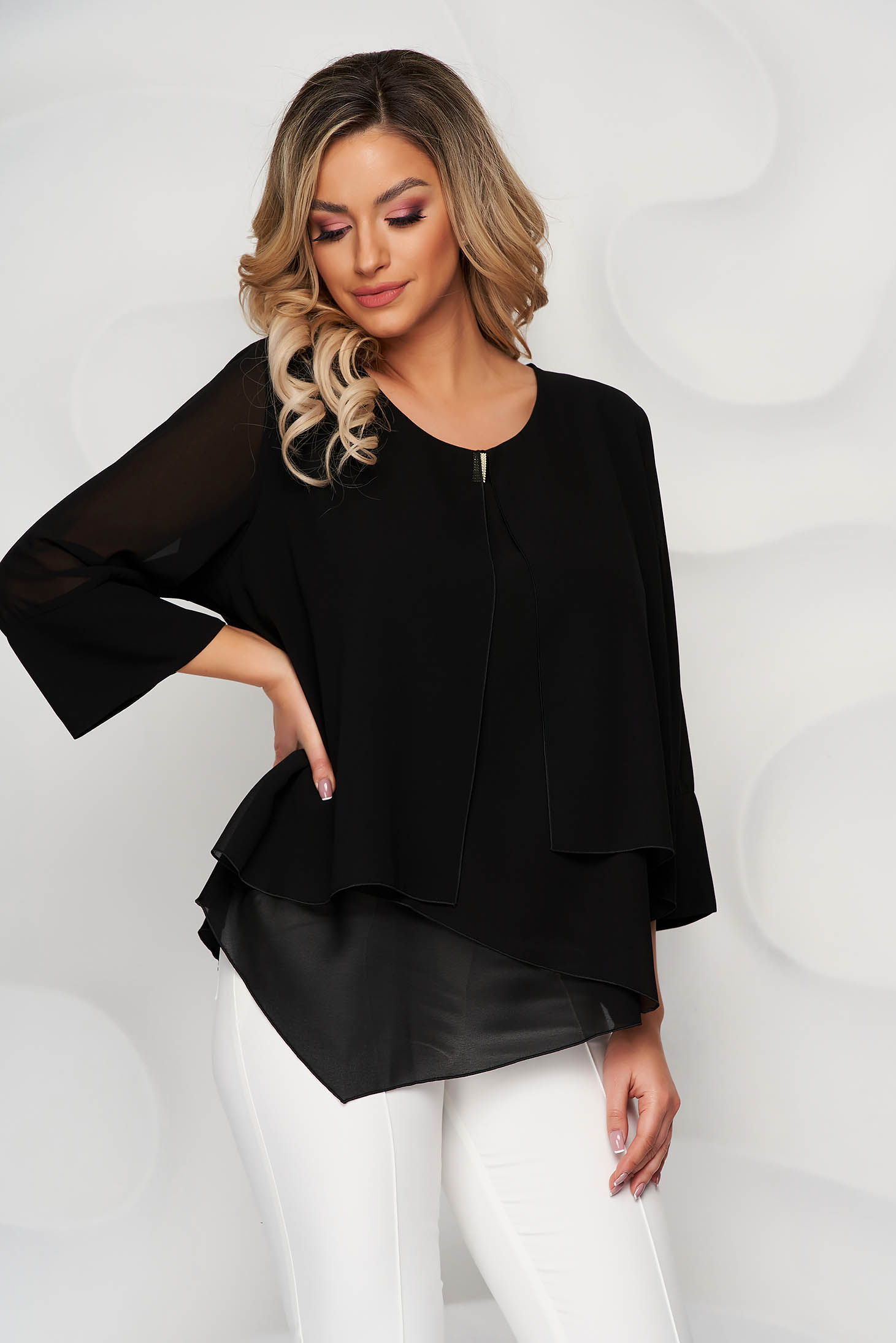 Black office asymmetrical flared women`s blouse short cut from veil fabric with metal accessories