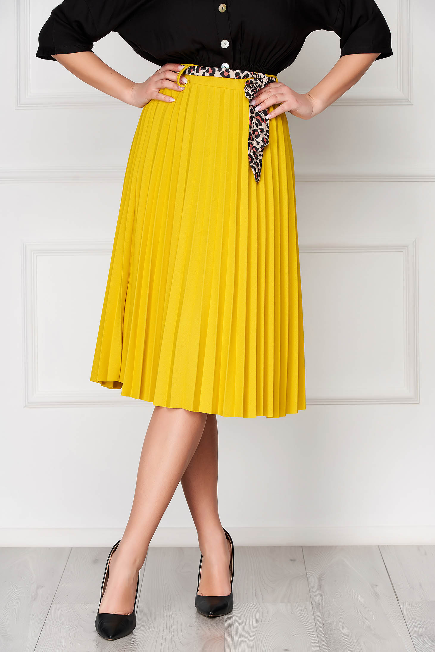 Yellow casual midi cloche skirt accessorized with belt pleats of material
