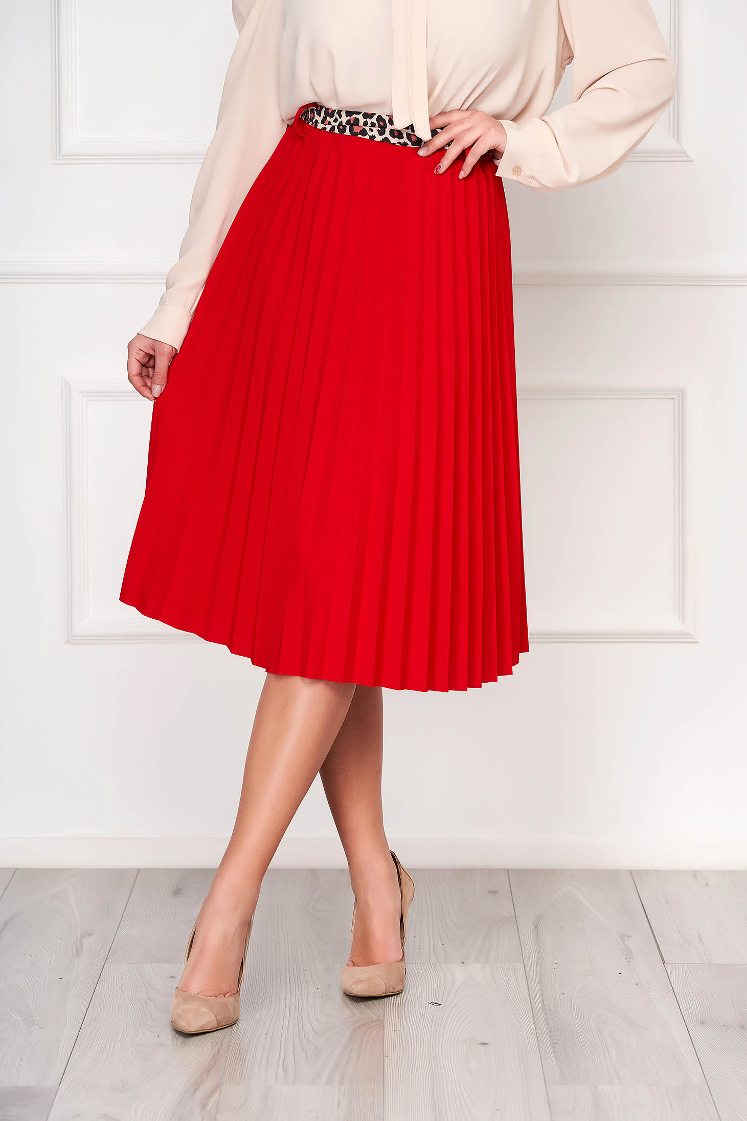Red casual midi cloche skirt accessorized with belt pleats of material