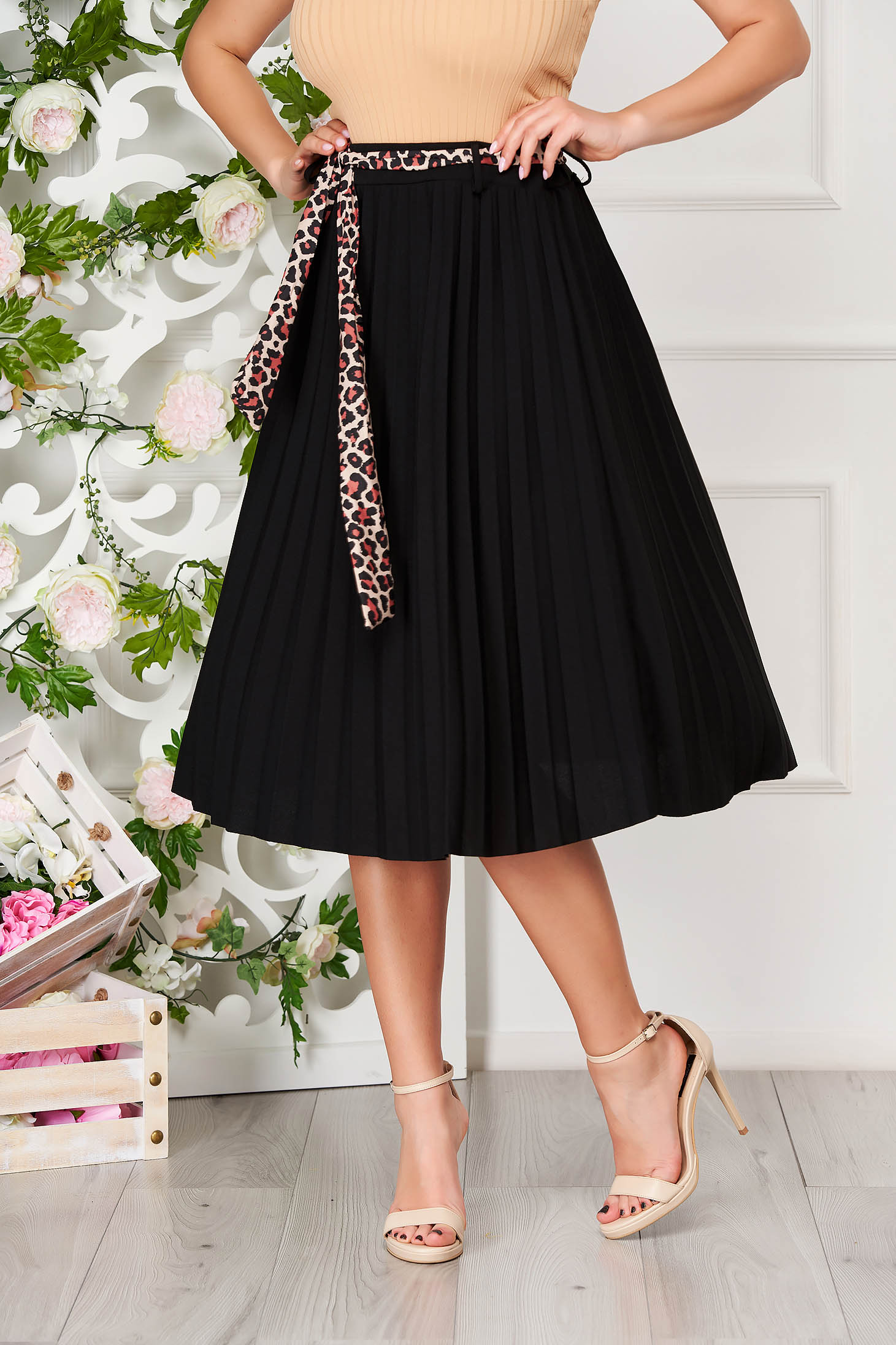 Black casual midi cloche skirt accessorized with belt pleats of material