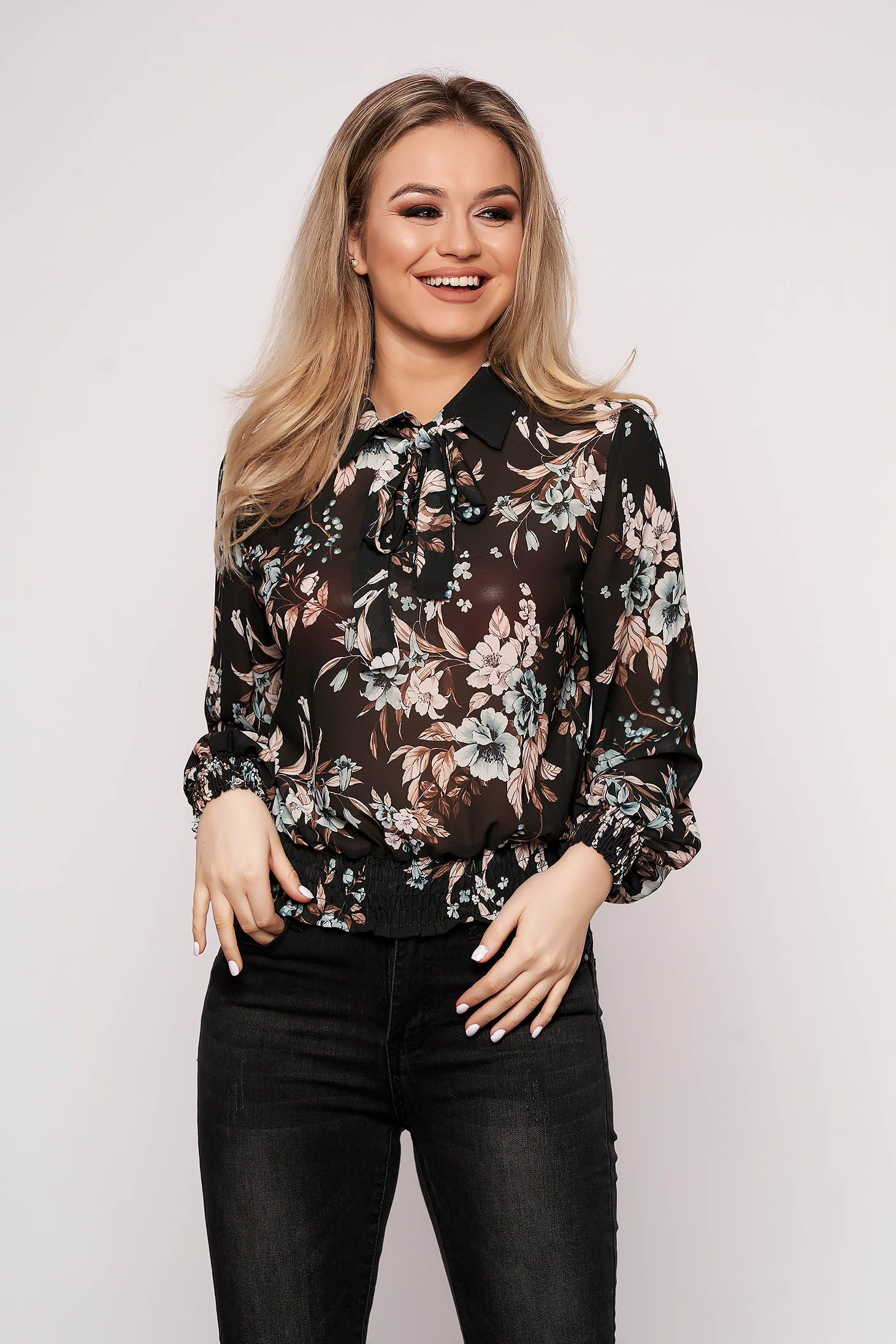 Black women`s blouse casual long sleeve flared short cut from veil fabric with floral print