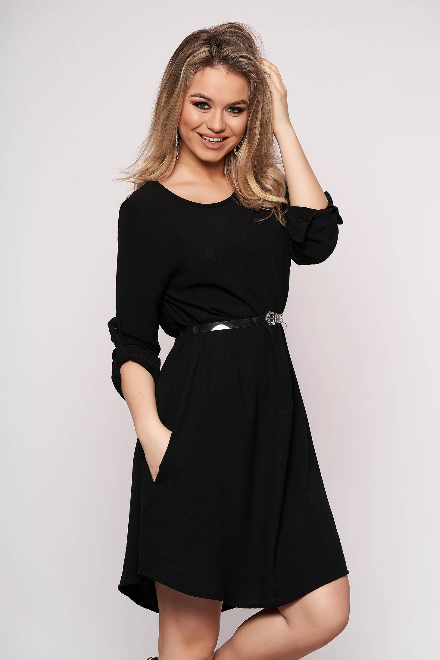 Black dress accessorized with belt flared asymmetrical casual with 3/4 sleeves