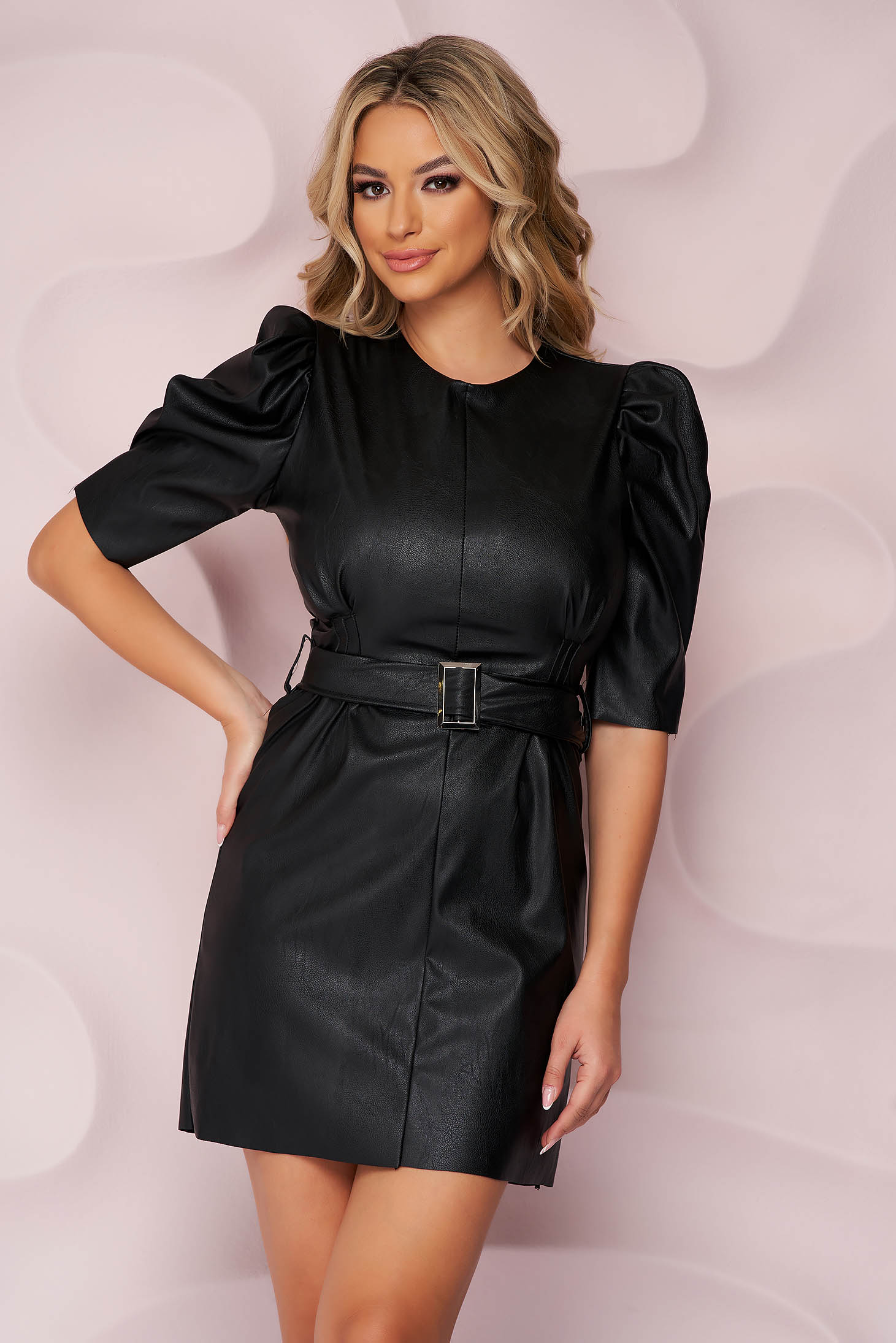 Black dress from ecological leather accessorized with belt with puffed sleeves short cut straight