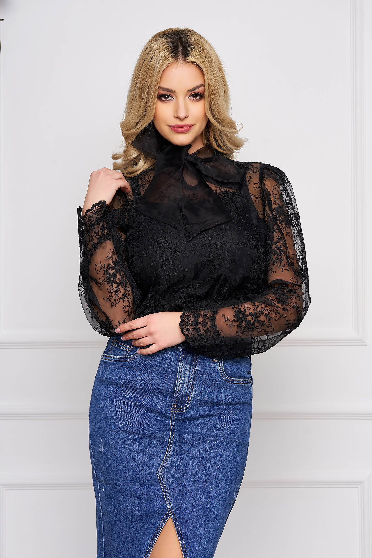 Black women`s blouse clubbing short cut from tulle from laced fabric long sleeved flared