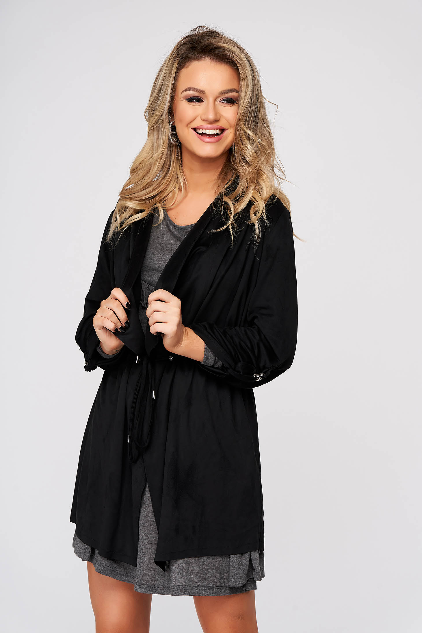 Black cardigan casual from velvet fabric is fastened around the waist with a ribbon
