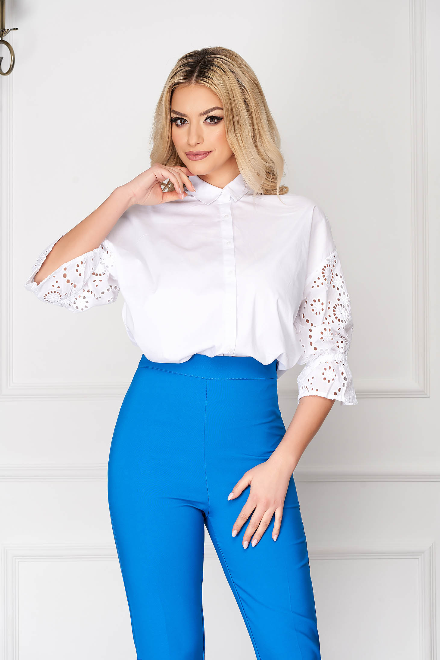 White office tented short cut women`s shirt with puffed sleeves with buttons