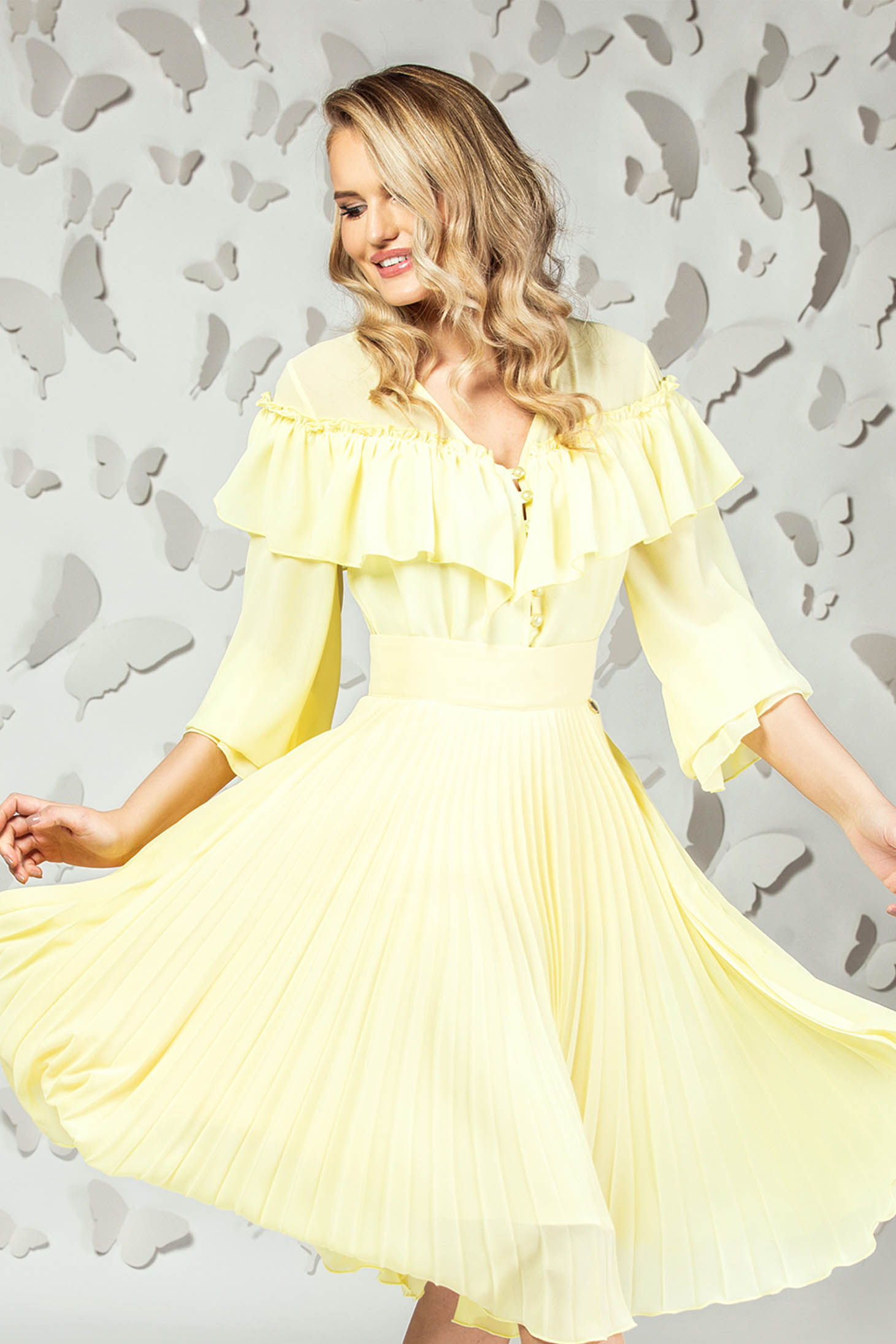 Yellow women`s blouse elegant short cut flared from veil fabric with ruffle details