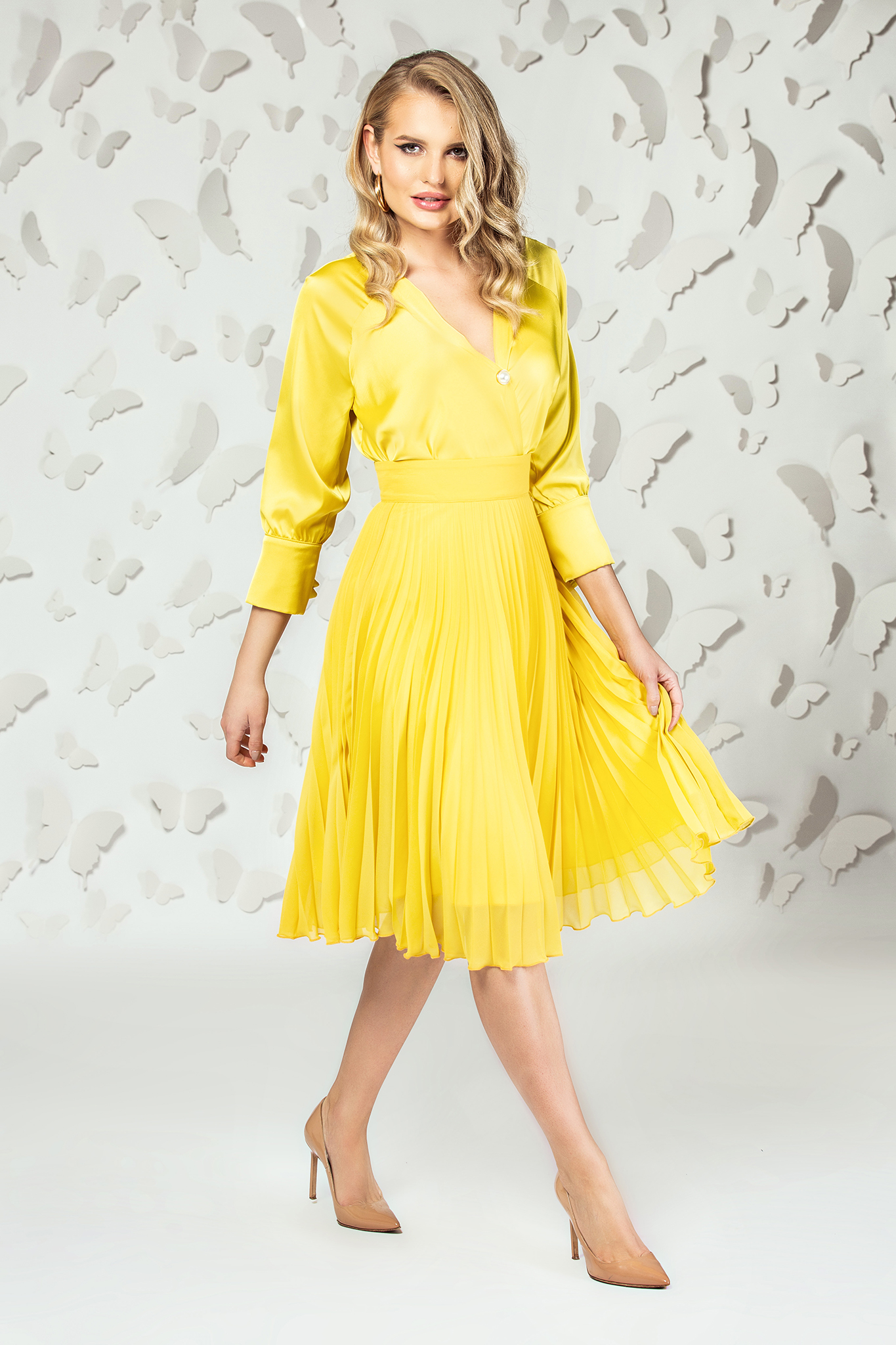 Mustard elegant midi cloche skirt from veil fabric folded up with inside lining