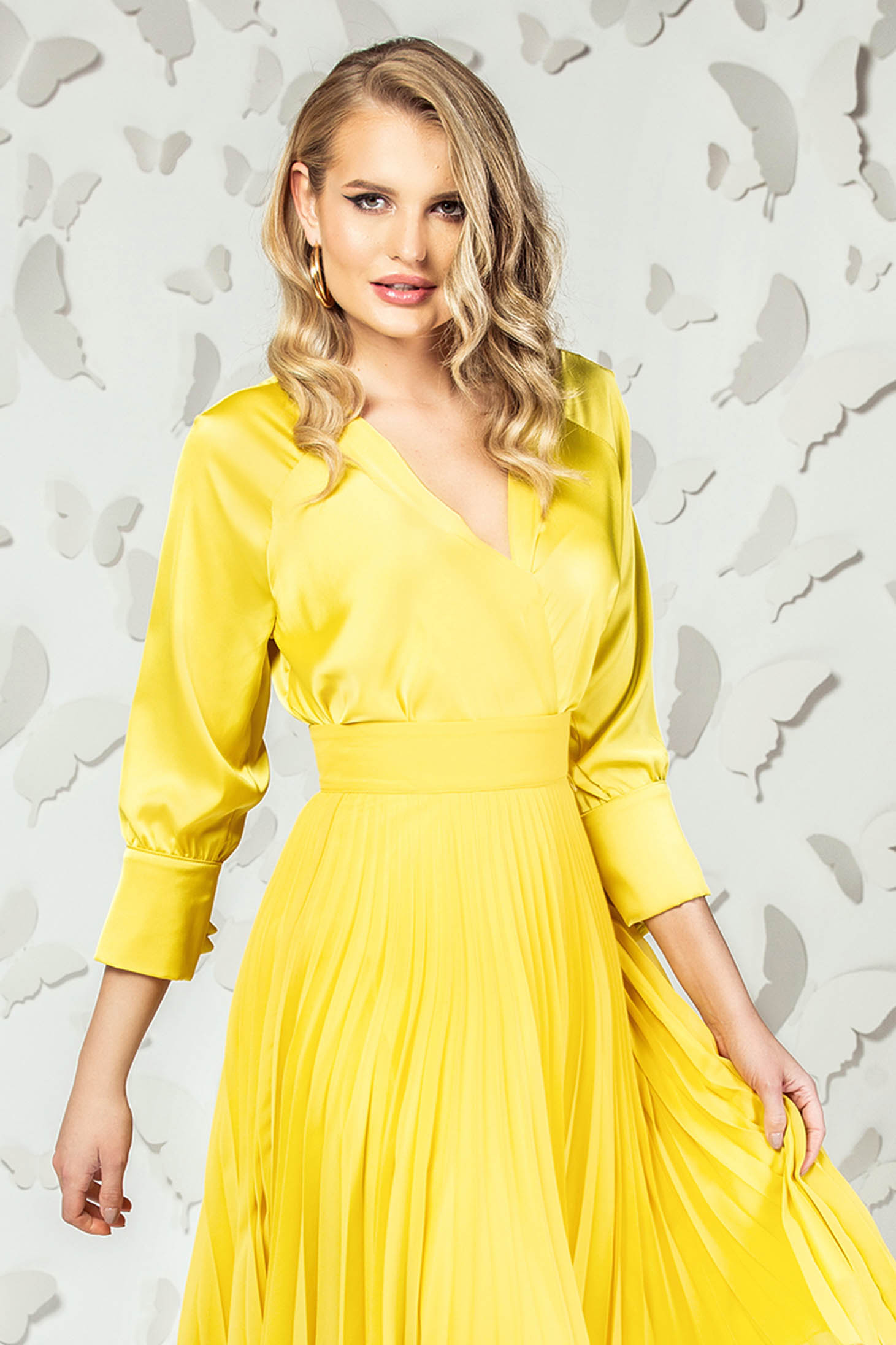 Yellow elegant short cut flared women`s blouse from satin with v-neckline
