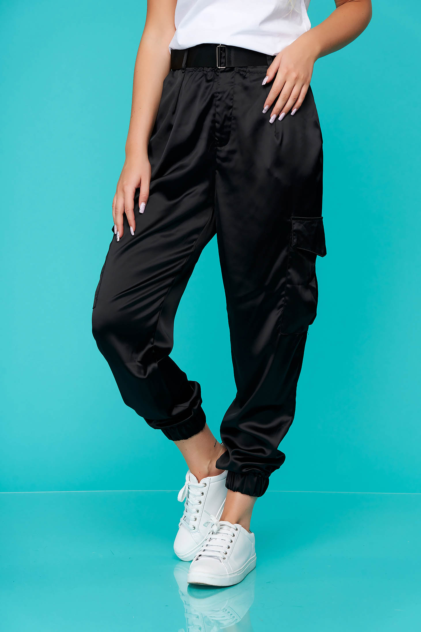 Black casual conical trousers from satin with pockets accessorized with belt
