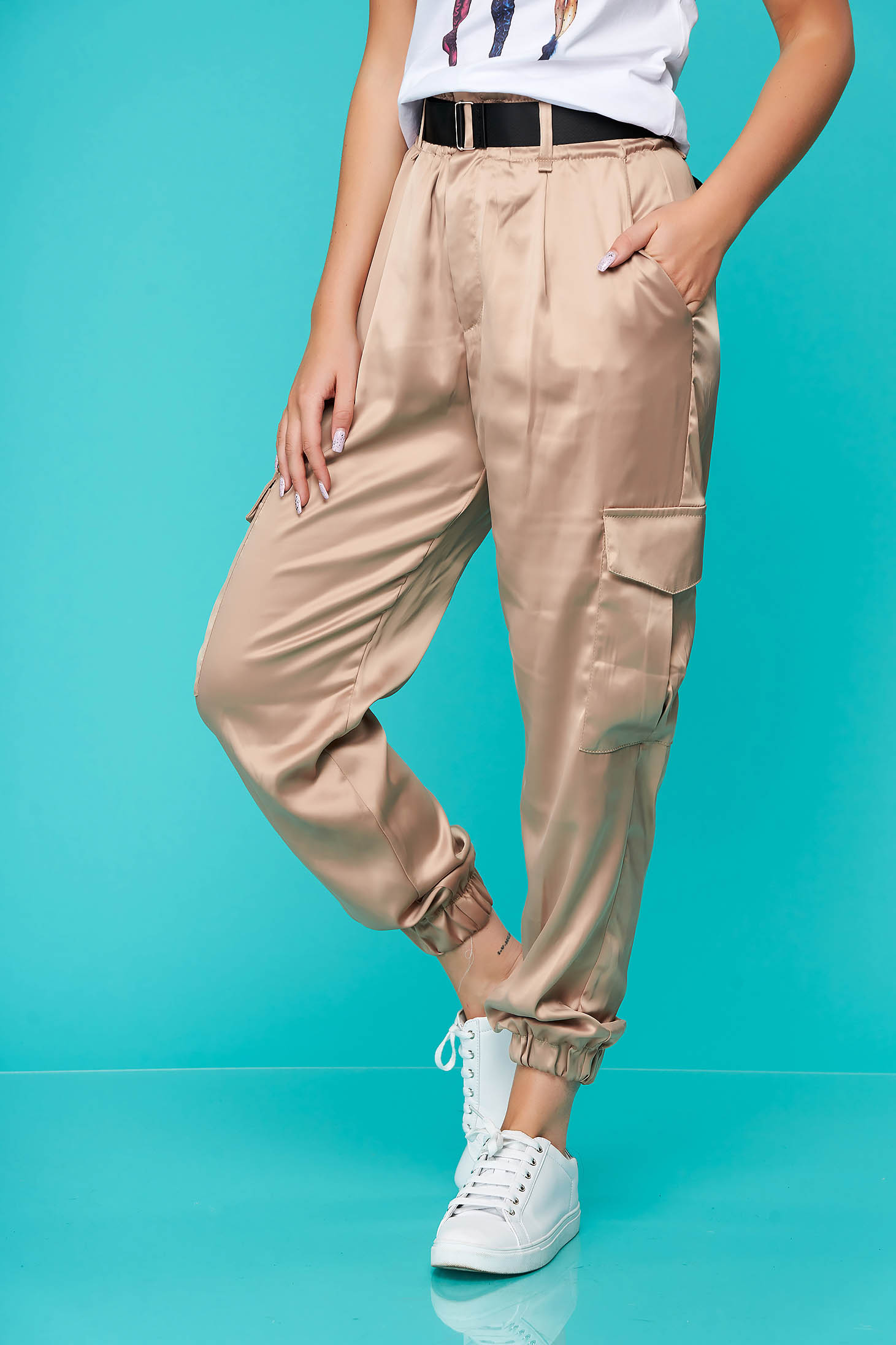 Cream casual conical trousers from satin with pockets accessorized with belt