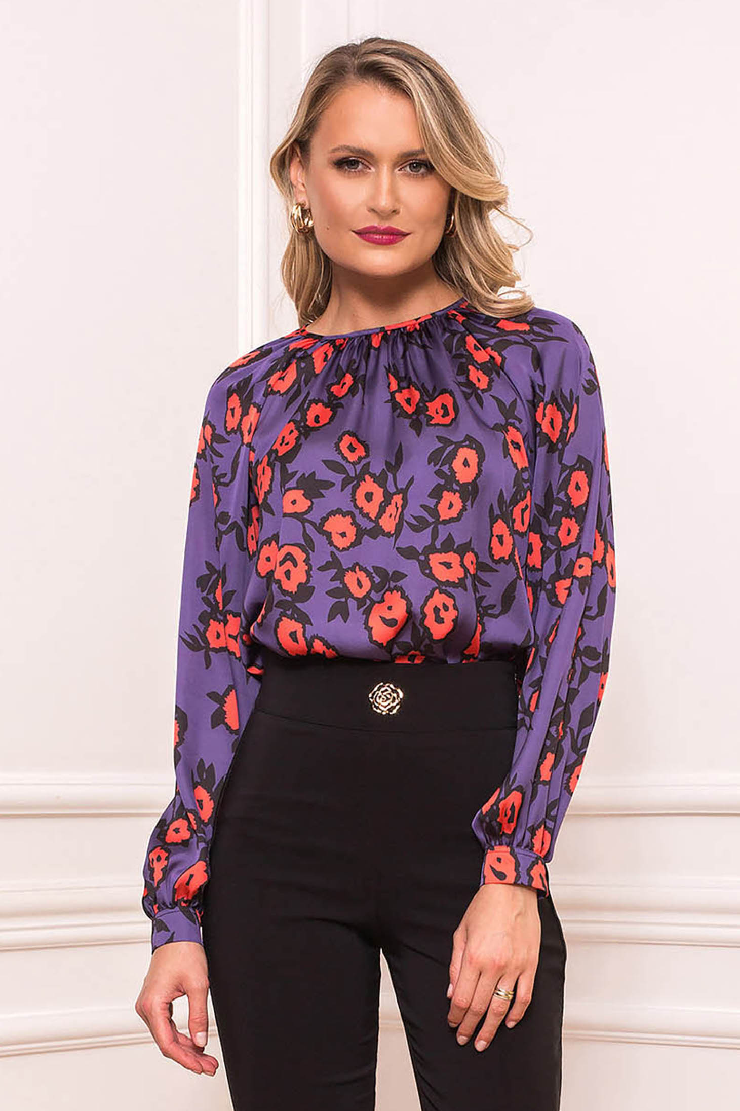 Purple women`s blouse elegant short cut flared long sleeved from satin fabric texture with floral print