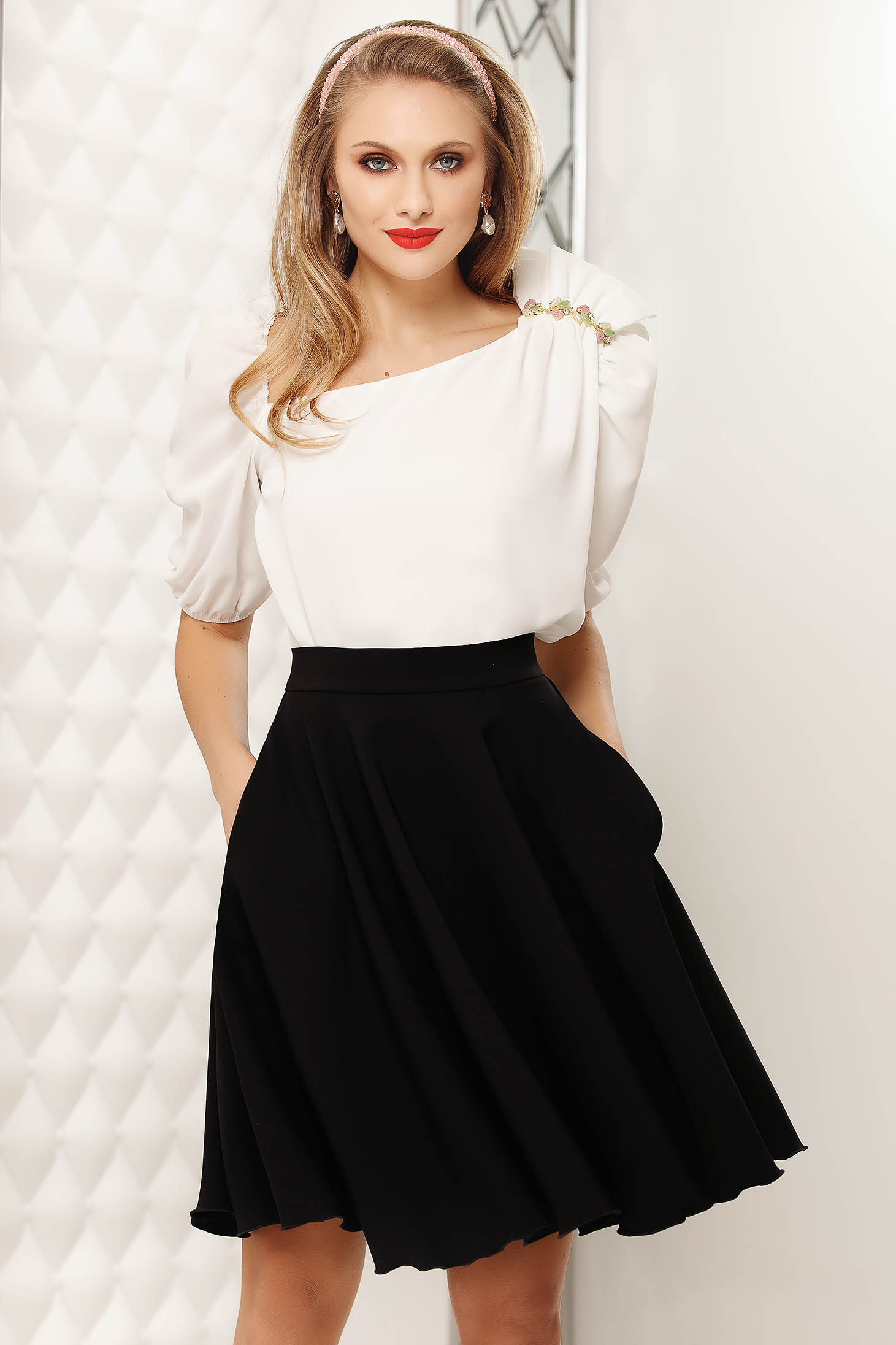 White elegant short cut flared women`s blouse with puffed sleeves