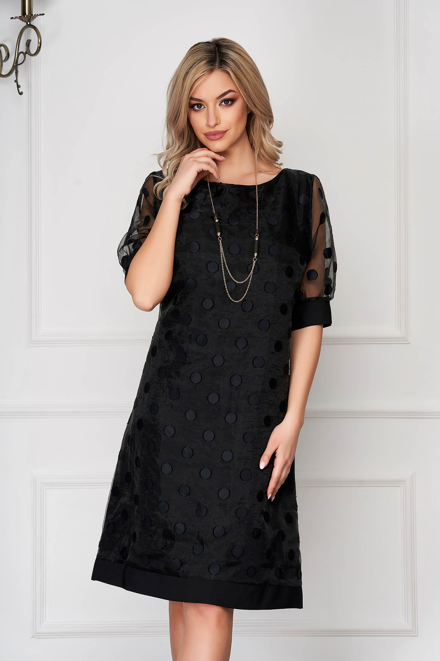 Black dress midi elegant a-line with veil sleeves accessorized with chain