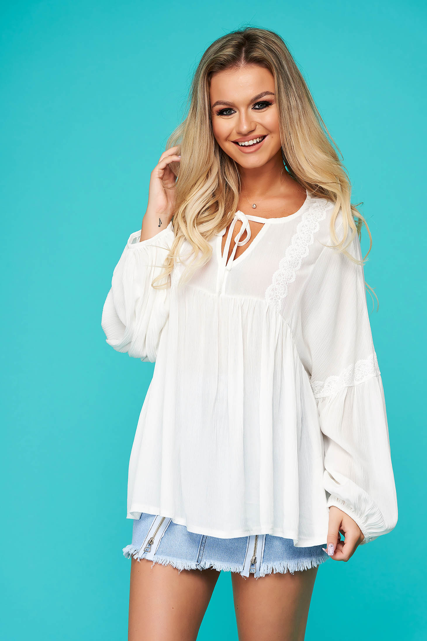 White women`s blouse casual flared guipure long sleeved