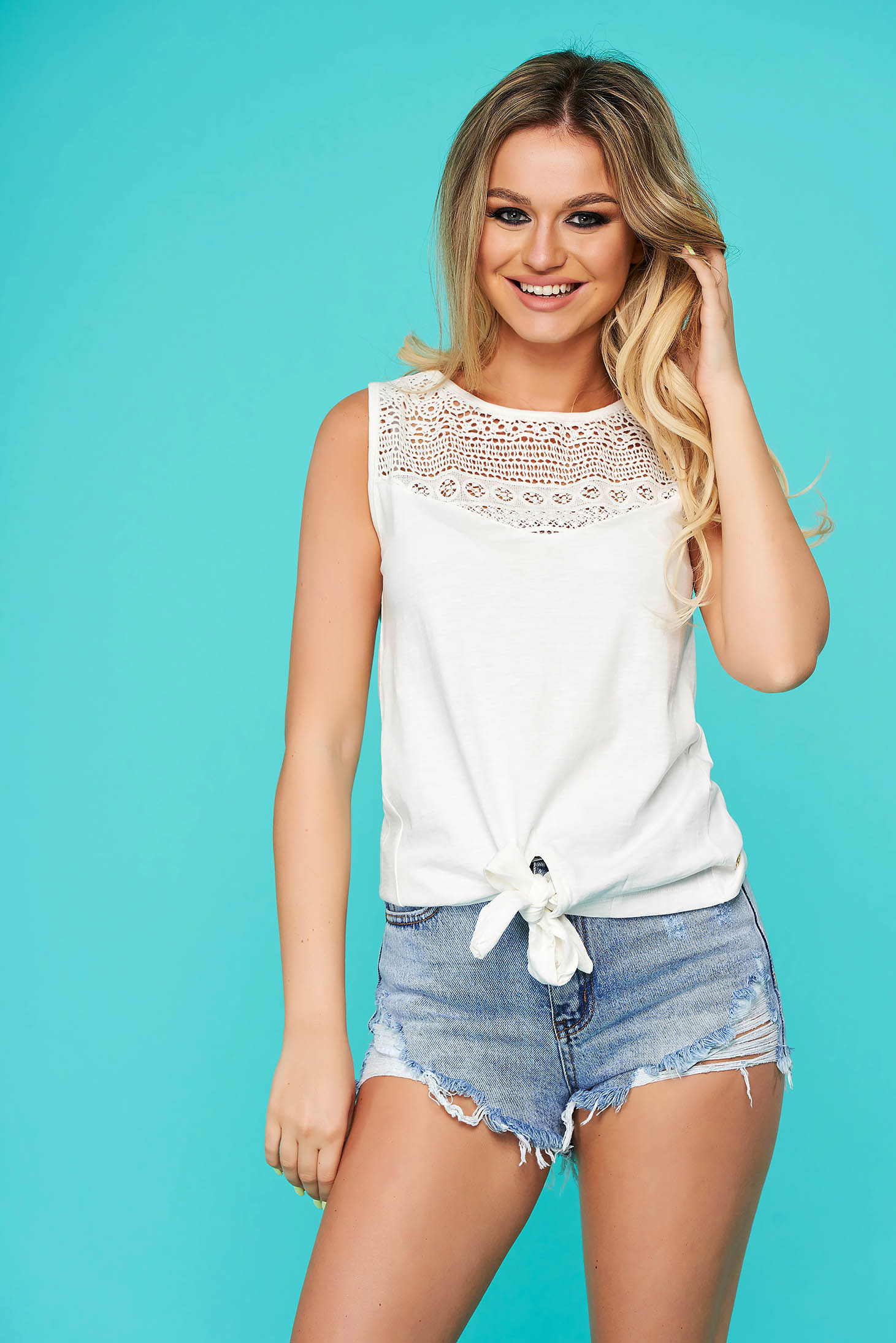 White women`s blouse casual flared thin fabric with embroidery details