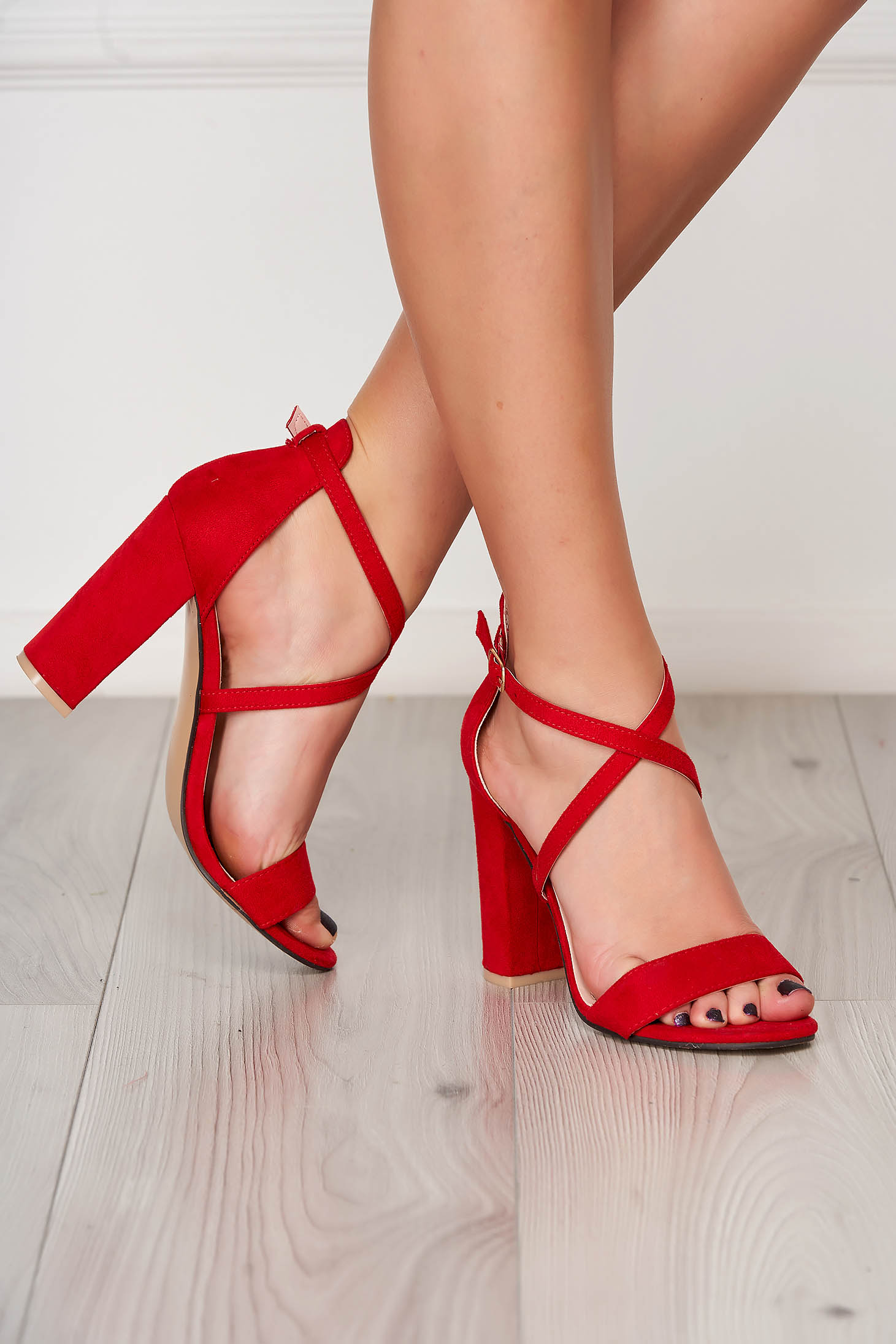 Red sandals with thin straps from ecological leather
