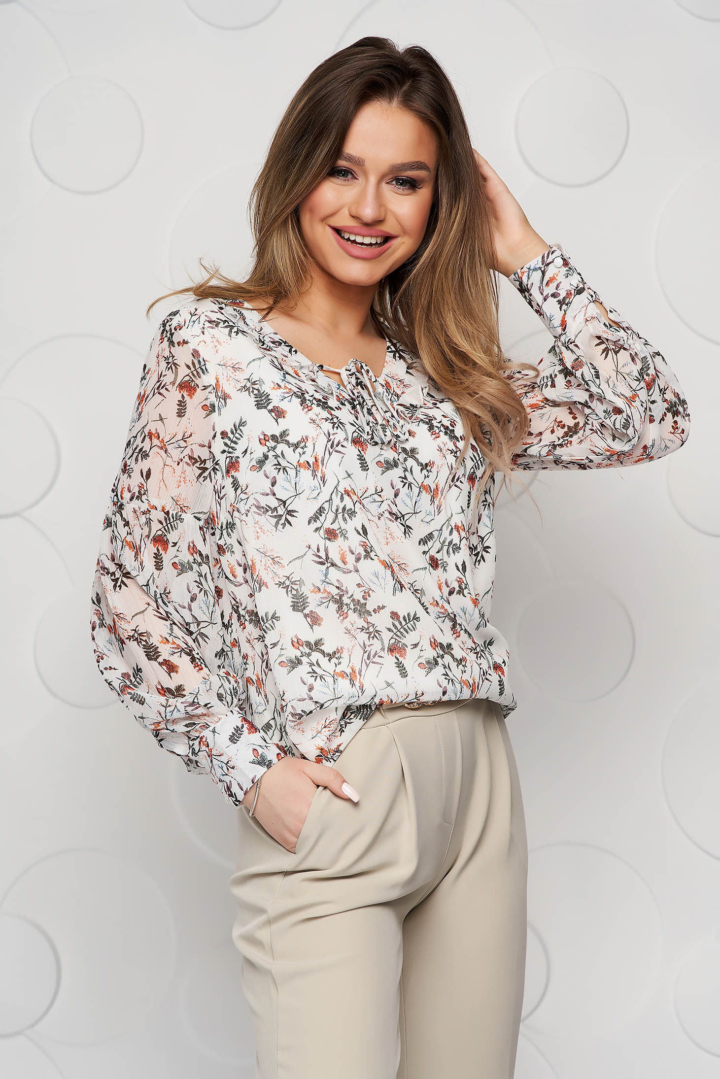 White women`s shirt casual from veil fabric flared with floral prints