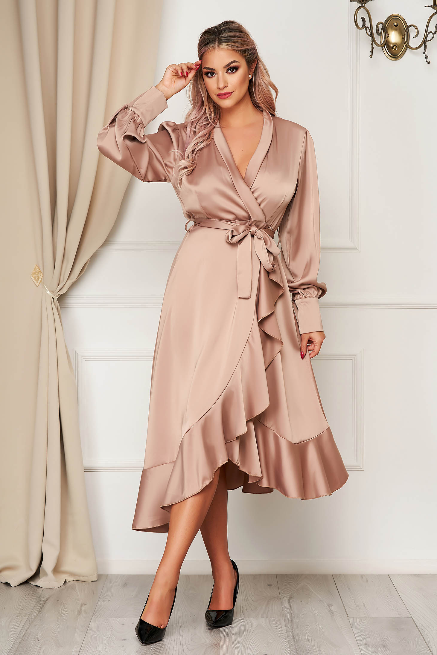 Cream dress elegant cloche wrap over front from satin fabric texture with ruffles at the buttom of the dress accessorized with tied waistband