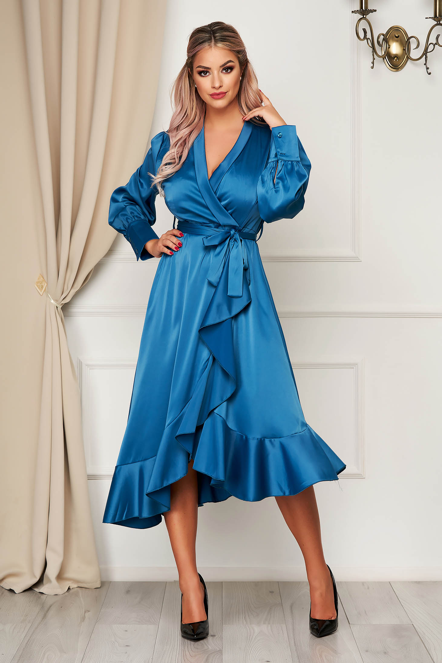 Turquoise dress elegant cloche wrap over front from satin fabric texture with ruffles at the buttom of the dress accessorized with tied waistband