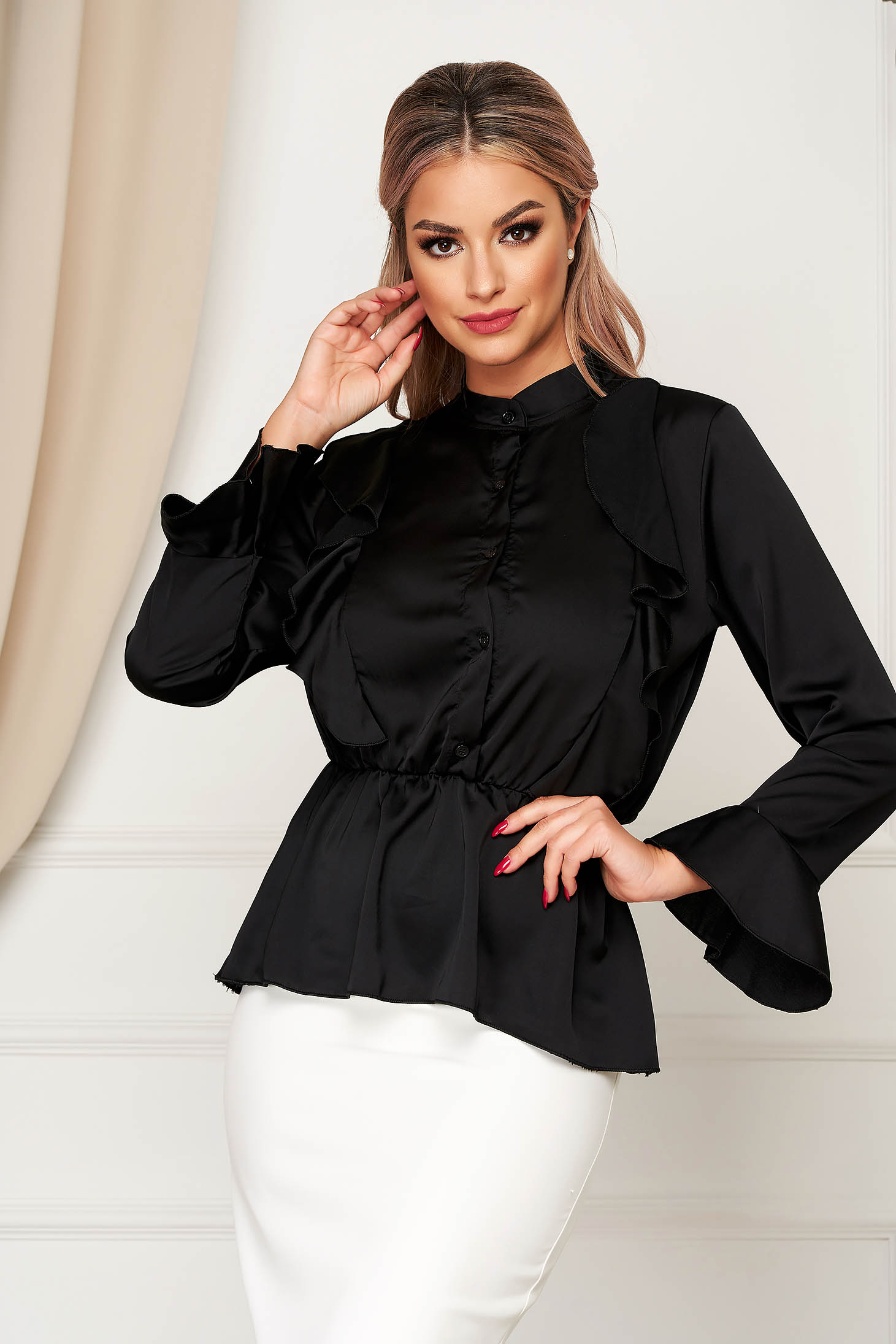 Black women`s shirt elegant flared from satin fabric texture with elastic waist with ruffle details