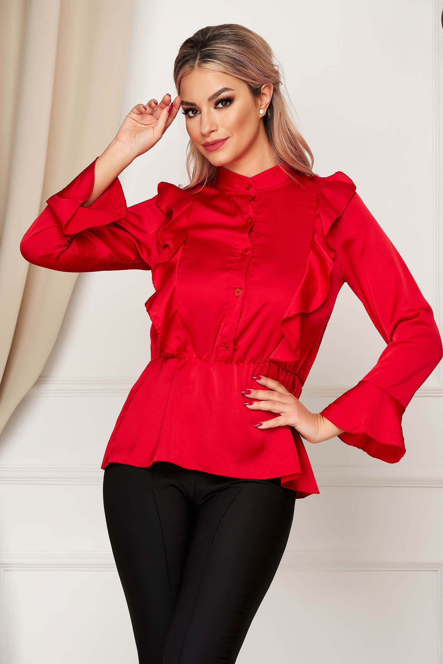 Red women`s shirt elegant flared from satin fabric texture with elastic waist with ruffle details