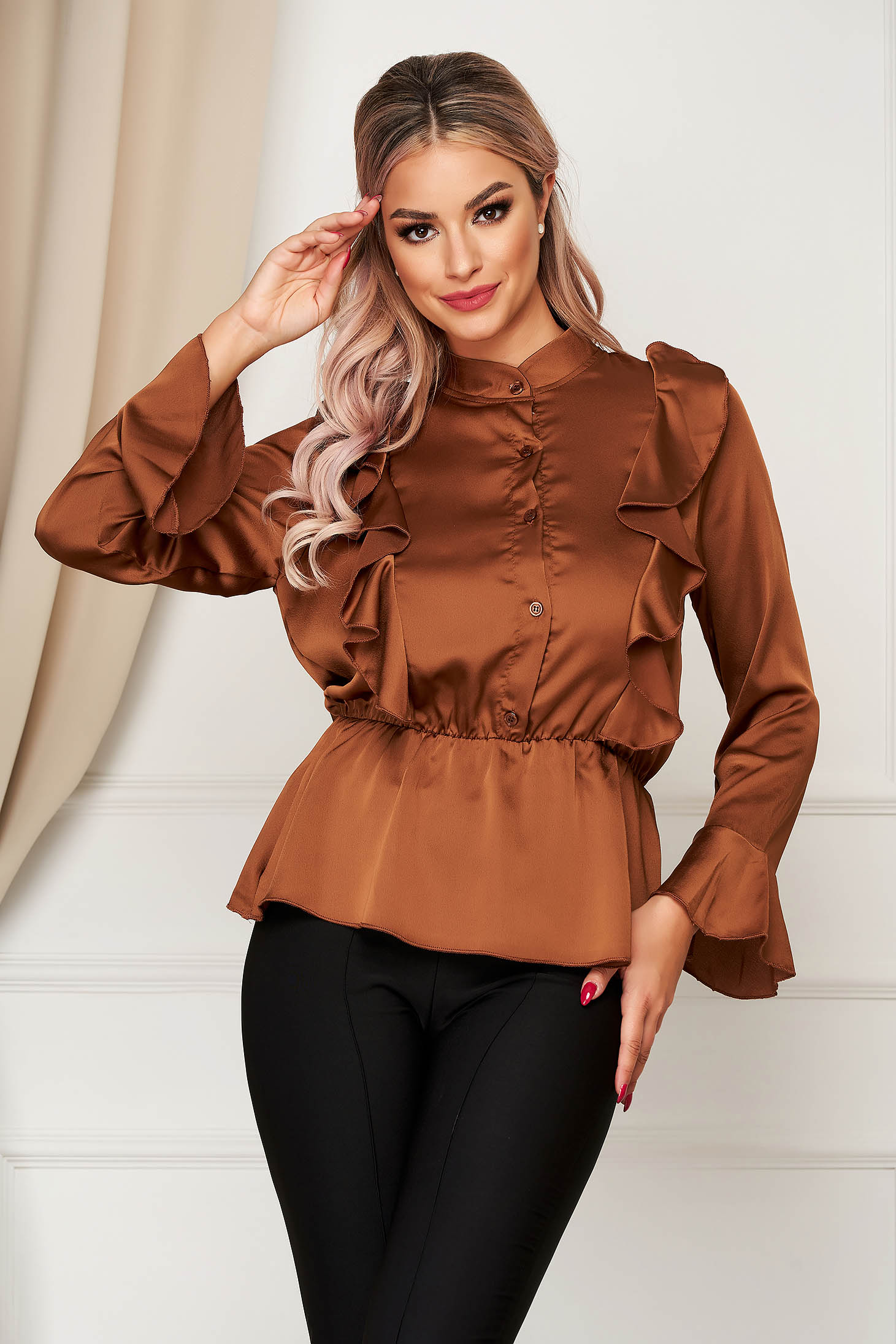 Brown women`s shirt elegant flared from satin fabric texture with elastic waist with ruffle details