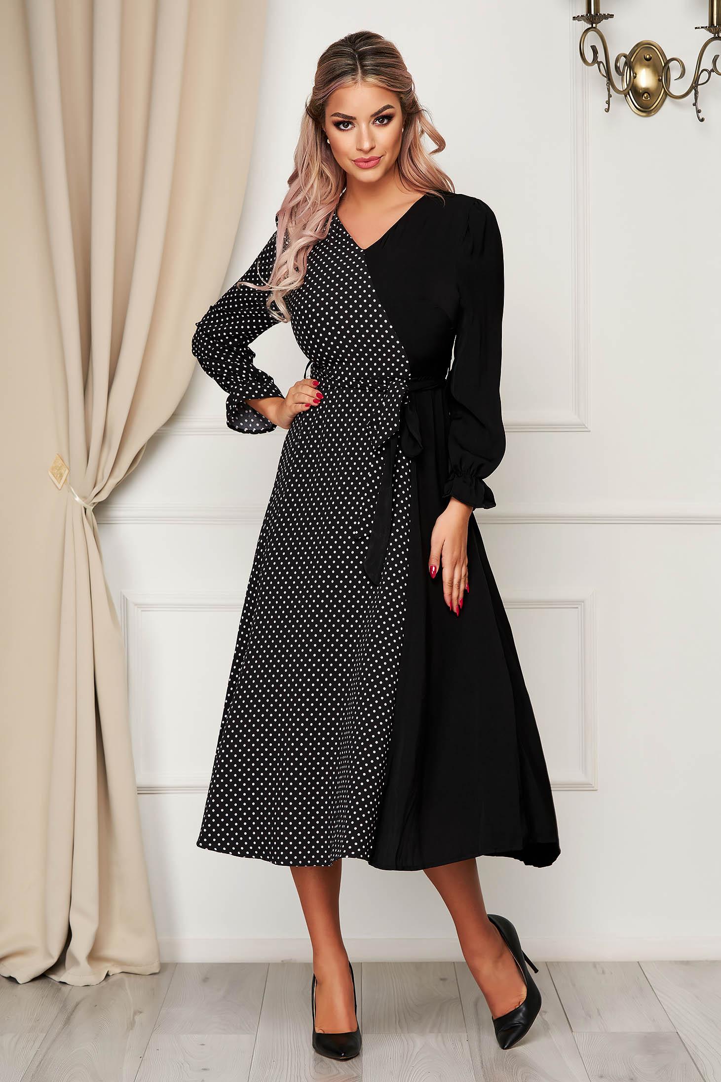 Black dress daily midi cloche with v-neckline accessorized with tied waistband