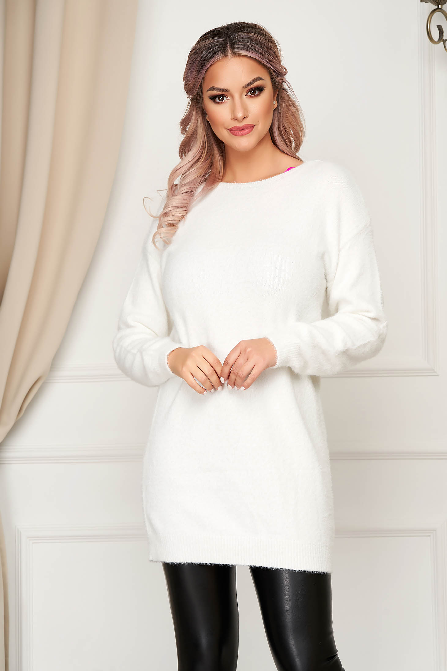 White sweater with easy cut with v-neckline with lace details knitted fabric